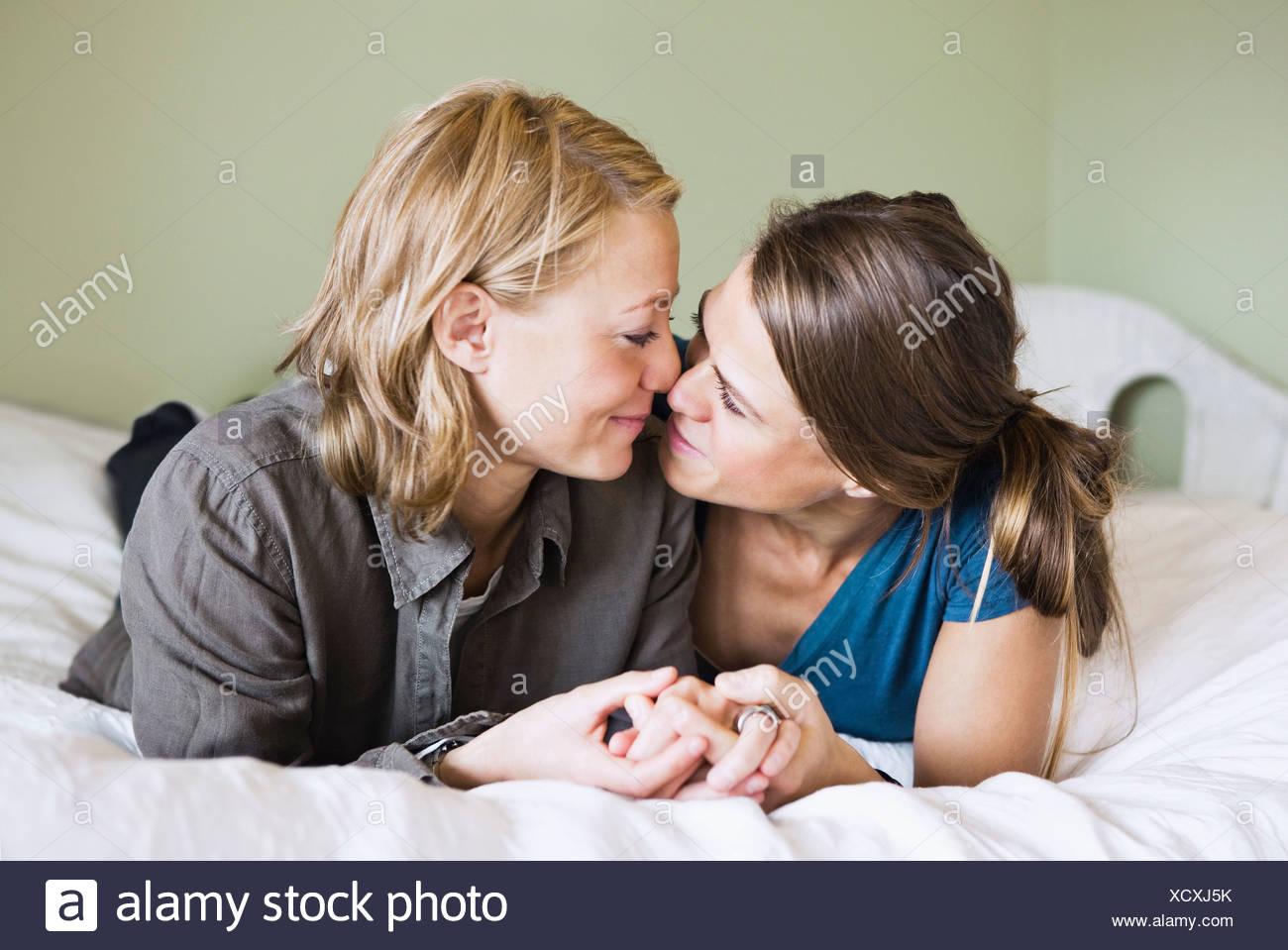 Female partners cuddle - Stock Image