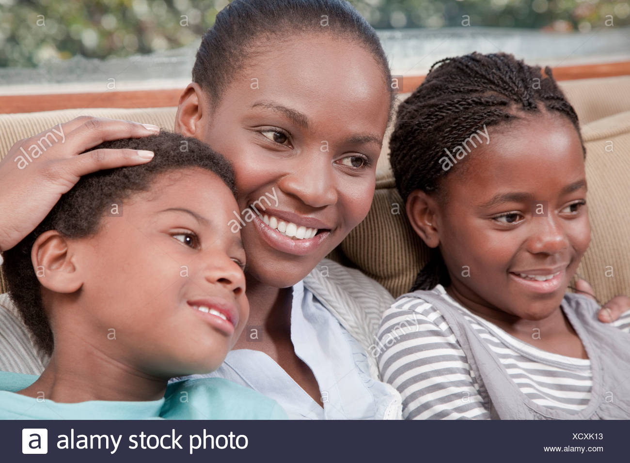 Mother and children happily sitting together, Illovo Family, Johannesburg, South Africa. - Stock Image