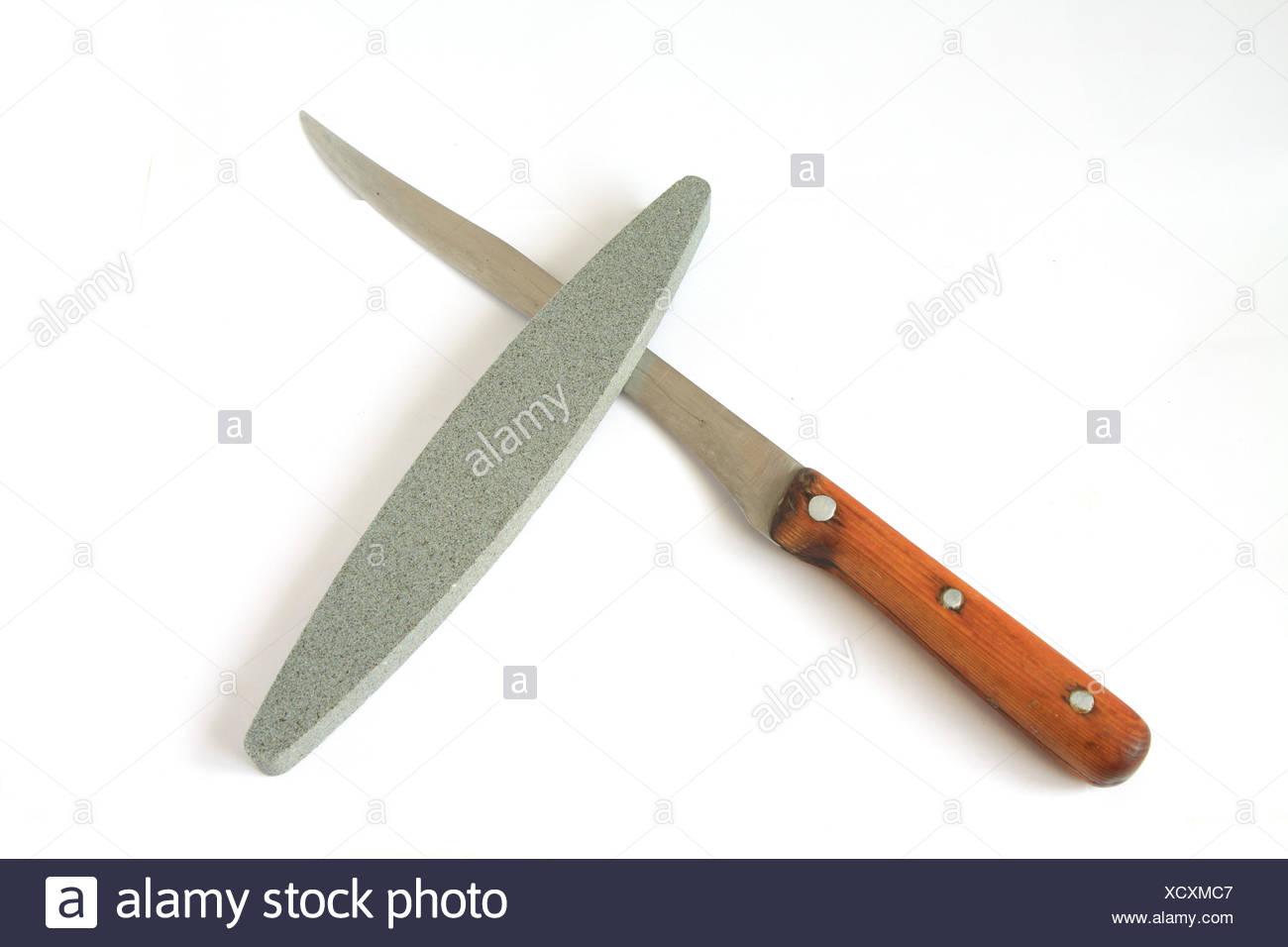 knife and emery on white background - Stock Image