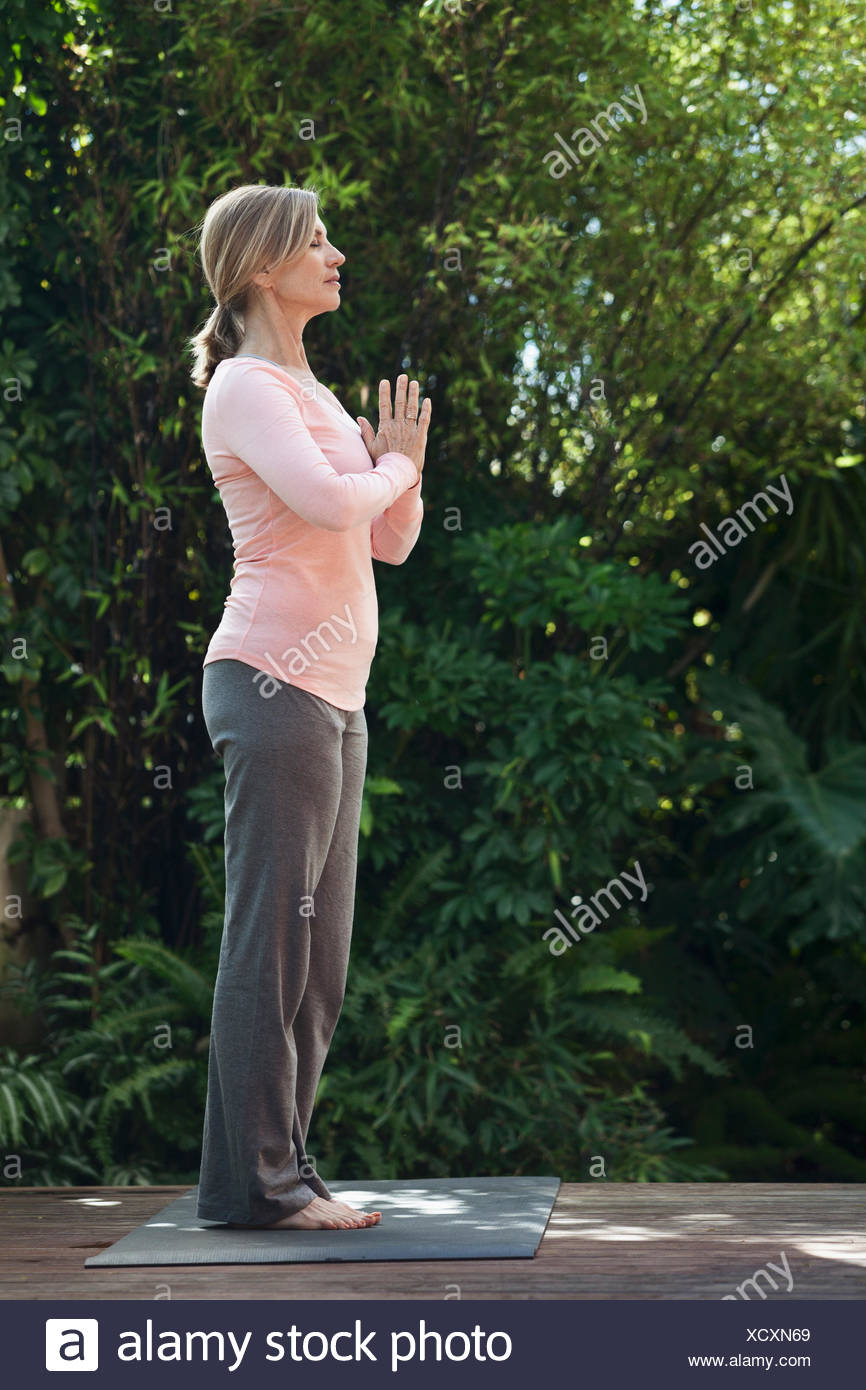 profile of woman in yoga pose - Stock Image