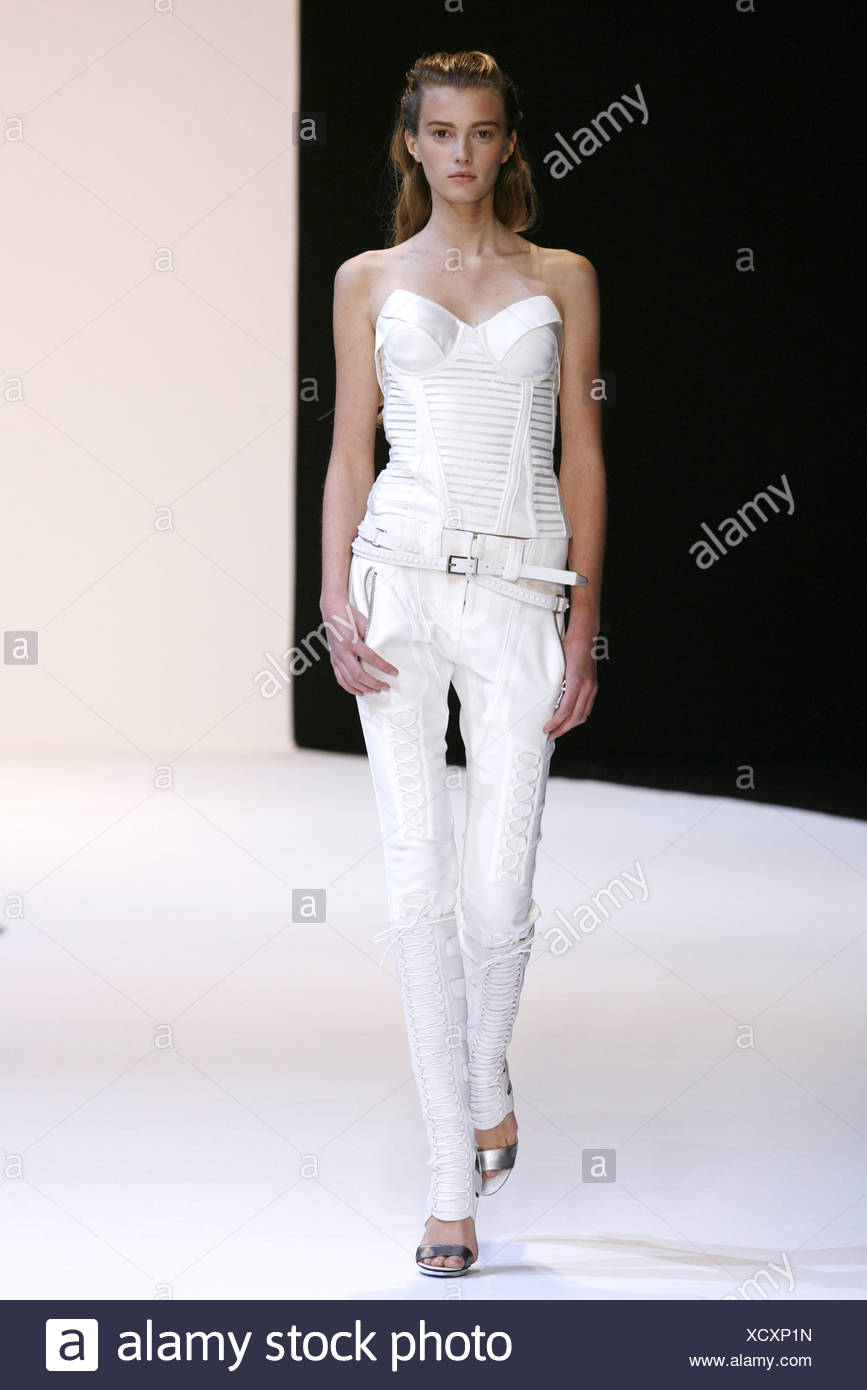 b901306ac64 Barbara Bui Paris Ready to Wear Spring Summer Model wearing tight white  lace up detail trousers