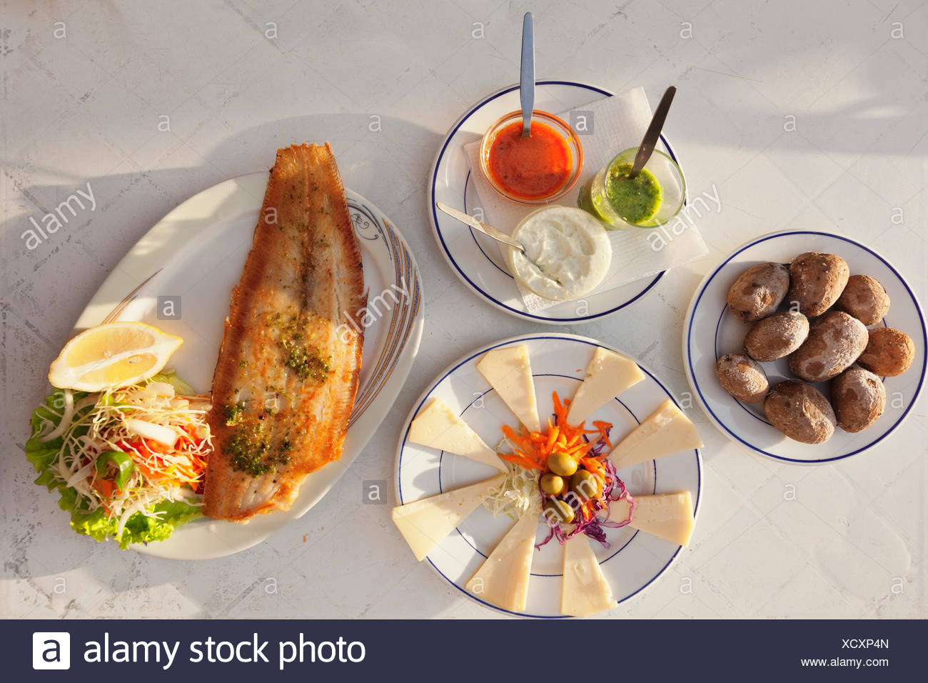 Papas arrugadas con mojo, wrinkled potatoes with mojo sauce, fried fish and cheese platter with Canarian cheese, La Gomera - Stock Image
