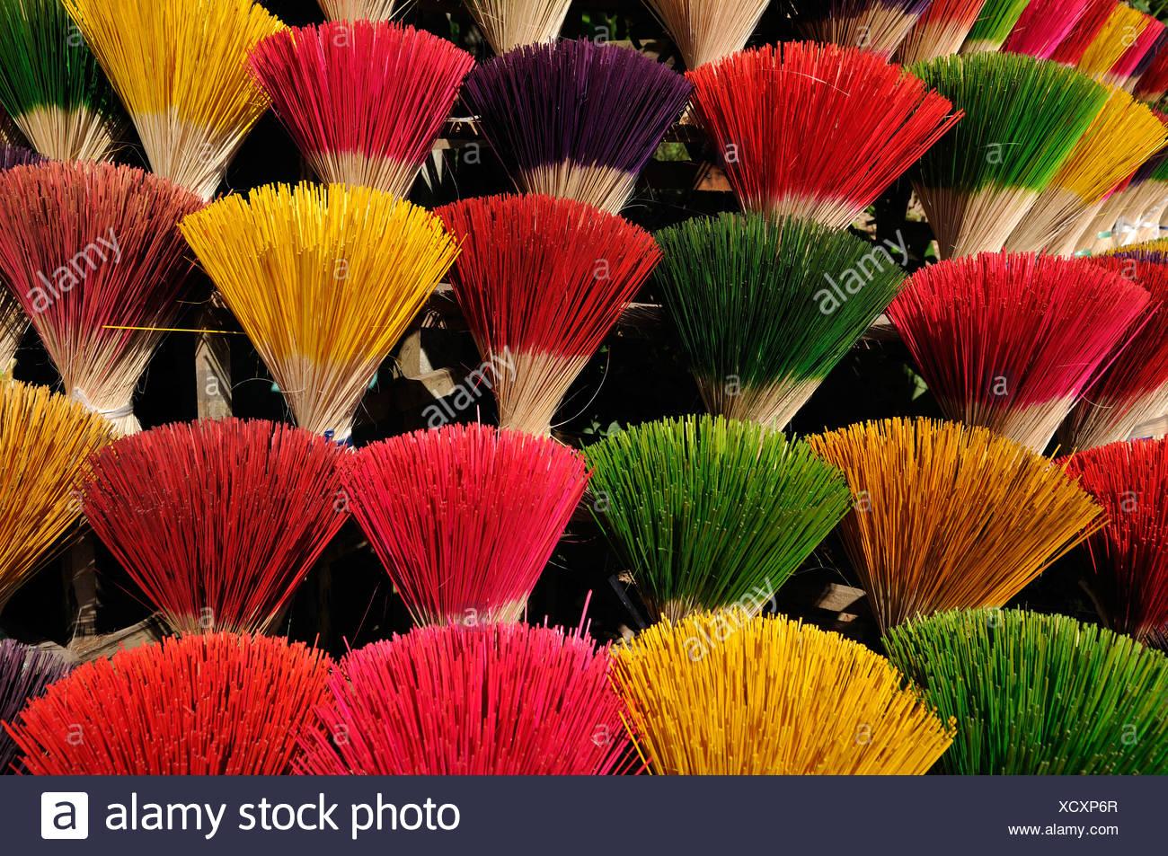 Colourful incense sticks, Hue, Vietnam, Asia - Stock Image