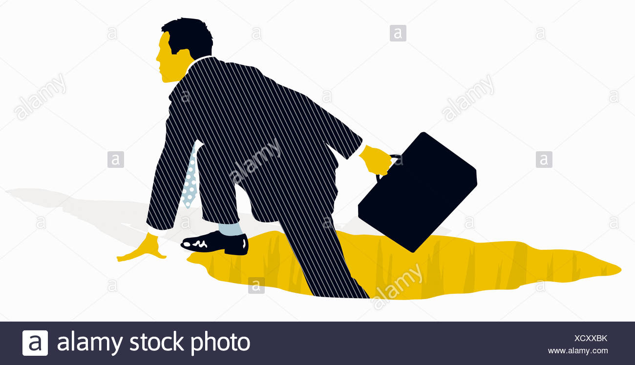 Businessman With Briefcase Climbing Out Of Hole