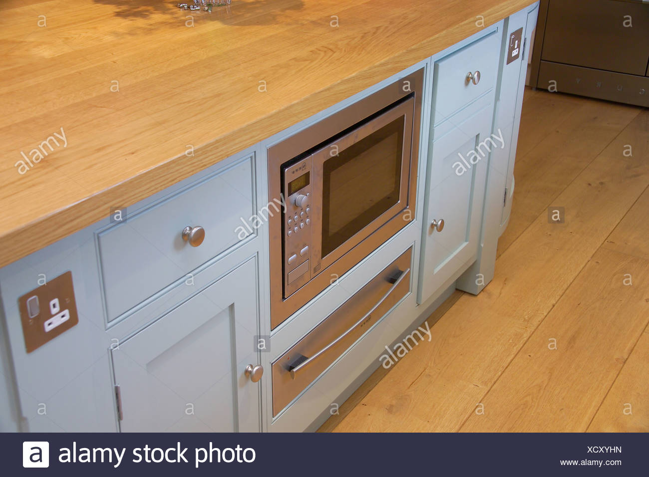 Close up of kitchen unit with built in microwave oven and ...