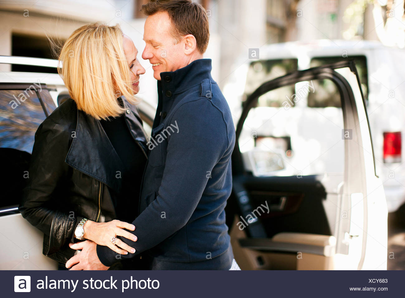 Man and woman happy to meet again - Stock Image