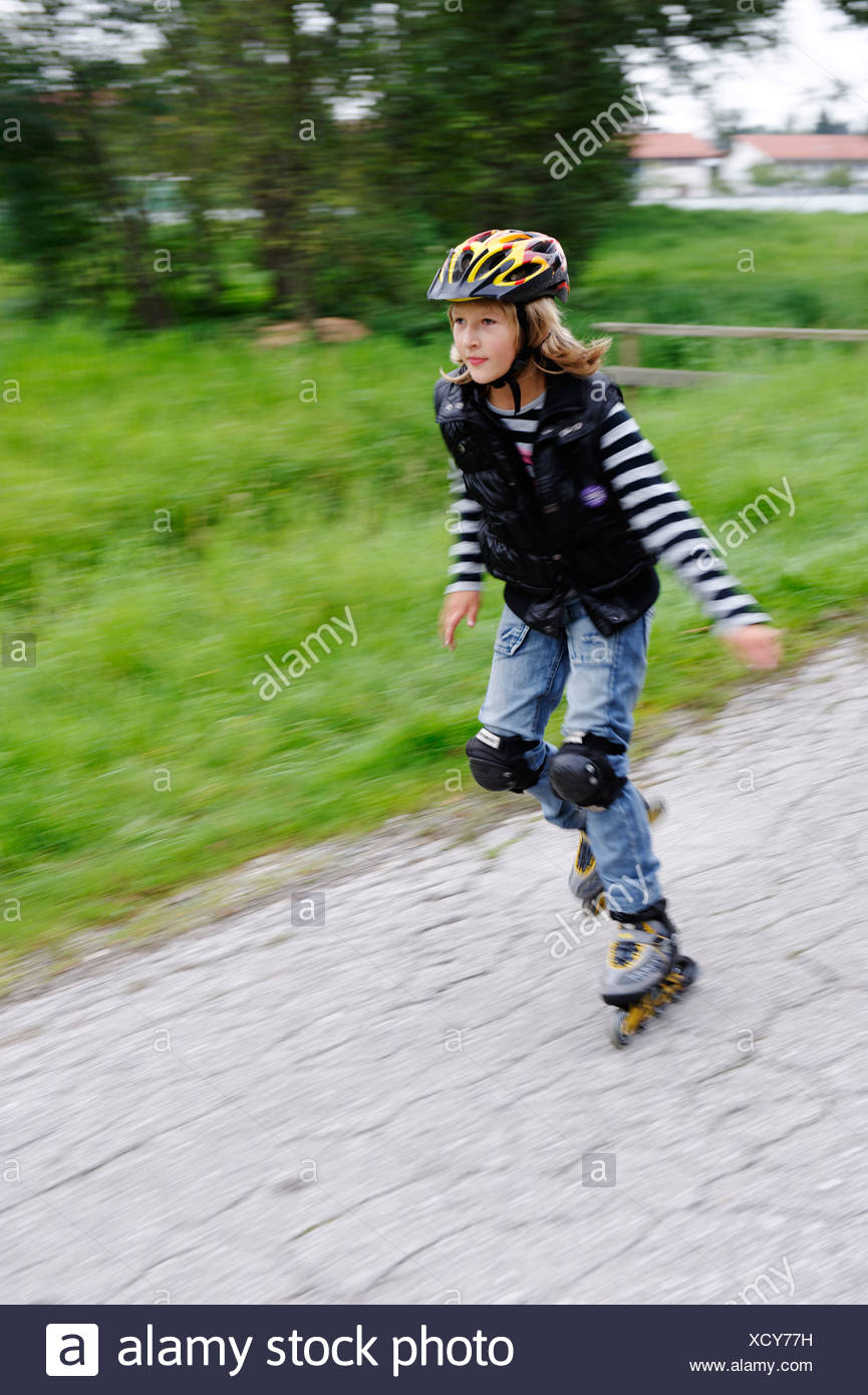 Girl rollerblading - Stock Image