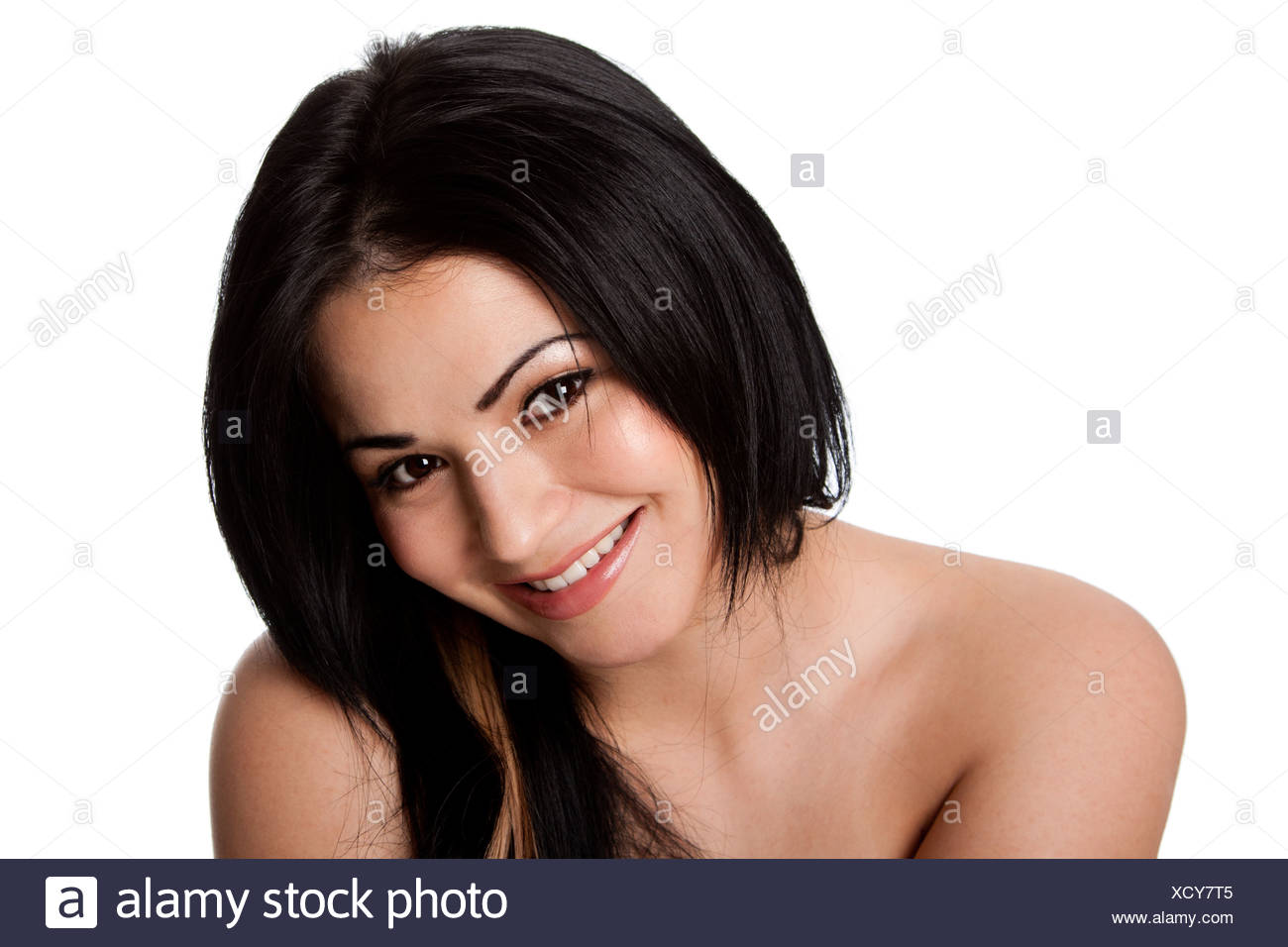 Beautiful attractive happy smiling young woman with perfect fair skin and long black hair, isolated. - Stock Image