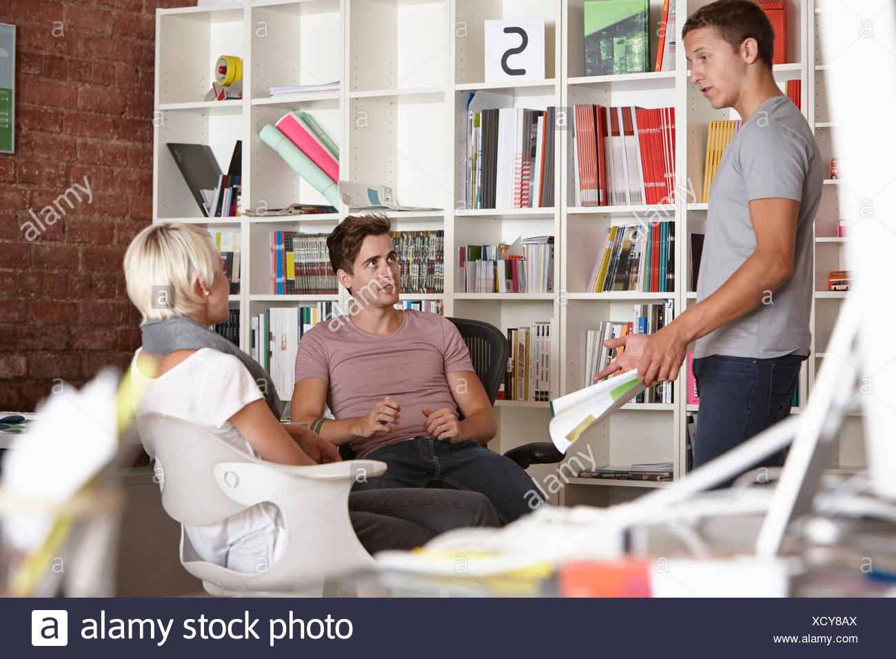 Colleagues having meeting - Stock Image