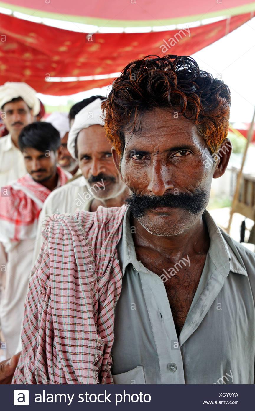 Man with a large mustache and henna-dyed hair, portrait, Muzaffaragarh, Punjab, Pakistan, Asia - Stock Image