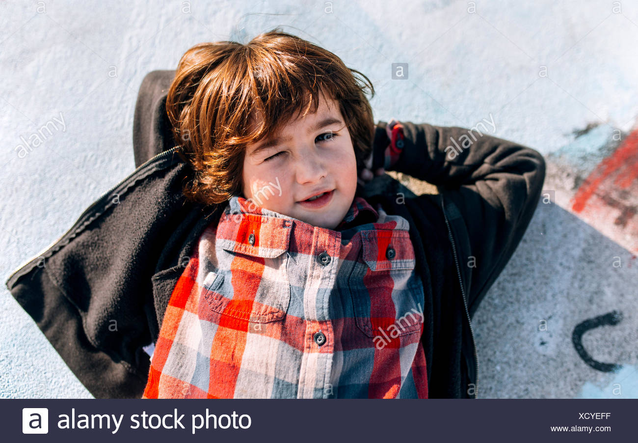 Portrait of relaxed little boy - Stock Image
