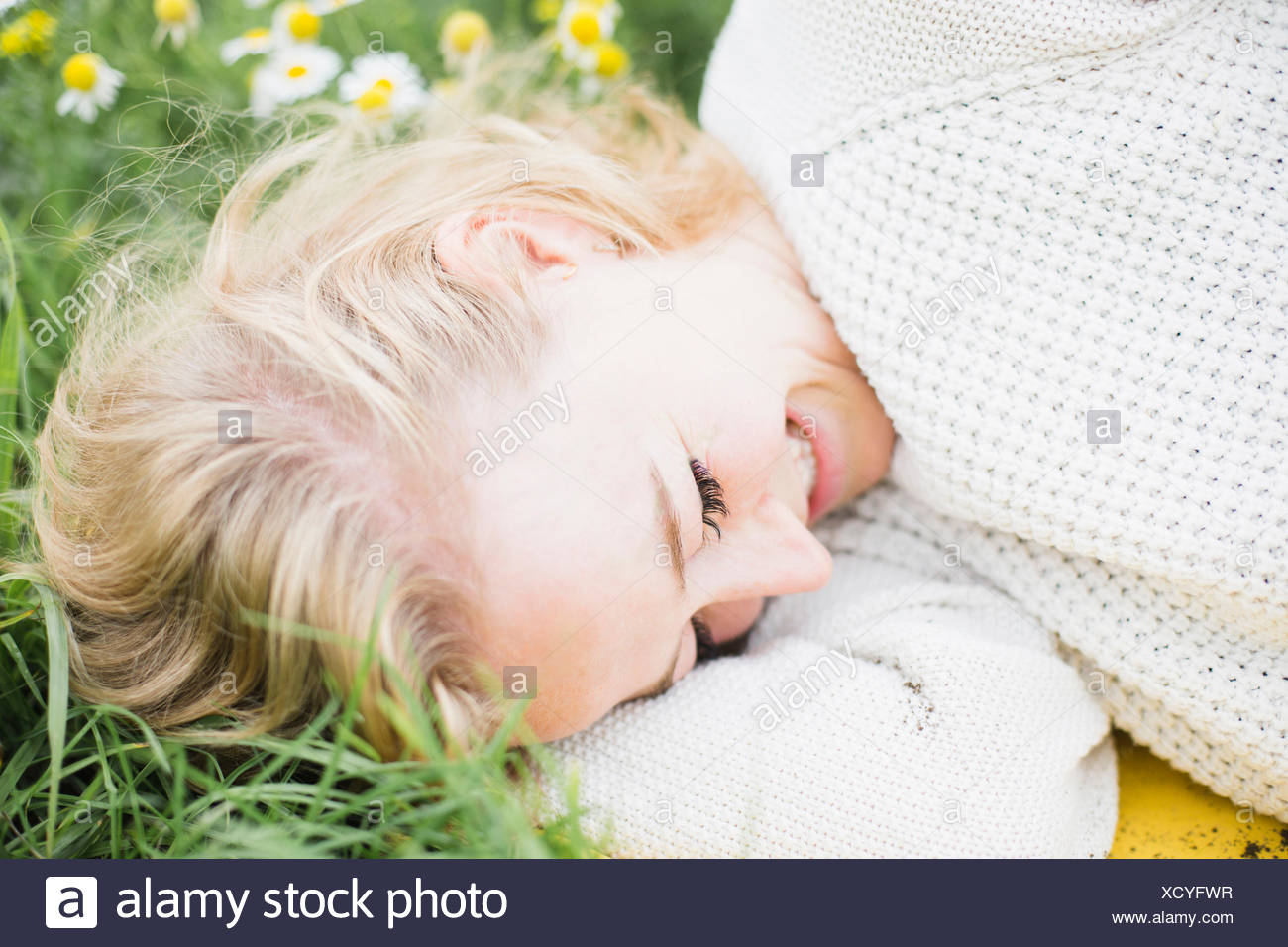 young woman smiling in nature - Stock Image