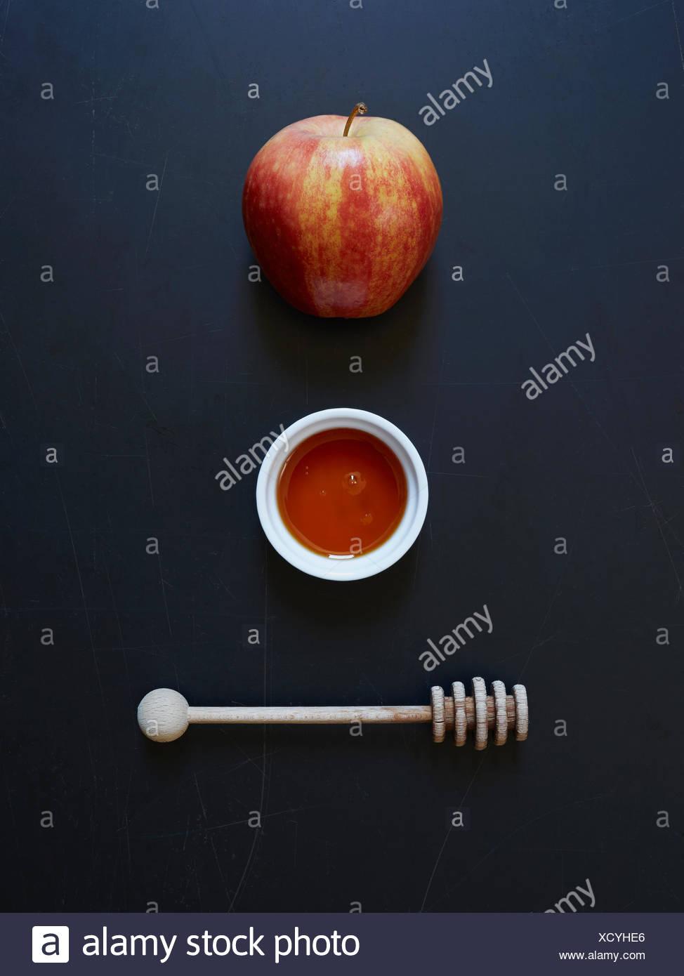 Apple honey and honey dripper - Stock Image