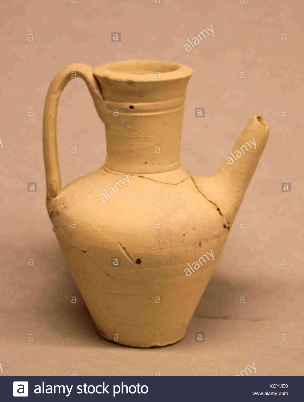 Ewer. Date: 9th century; Geography: Excavated in Iran, Nishapur; Medium: Earthenware; slip covered, unglazed; Classification: Ceramics; Credit Line: Stock Photo