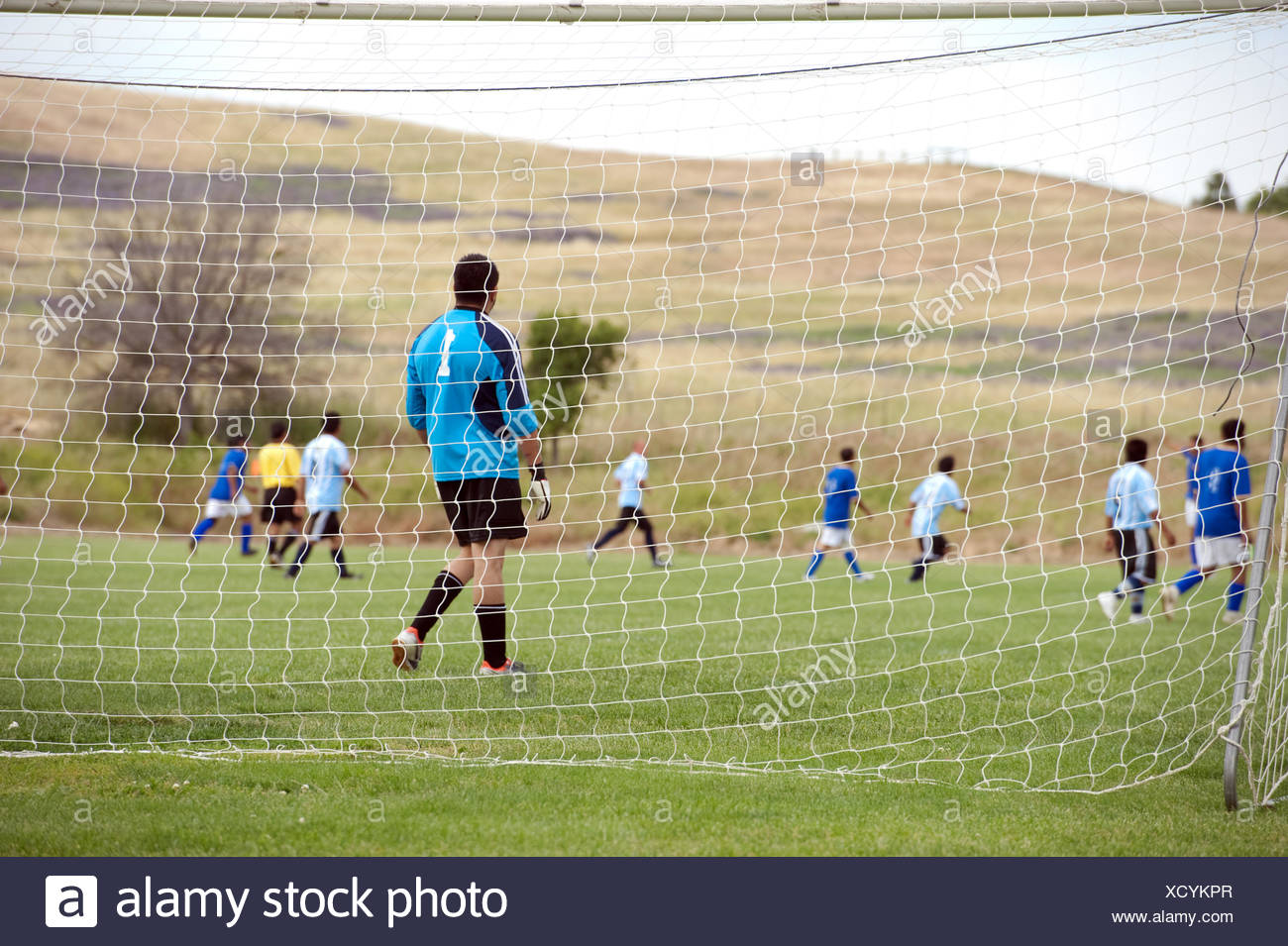 goalie waiting at goal post - Stock Image