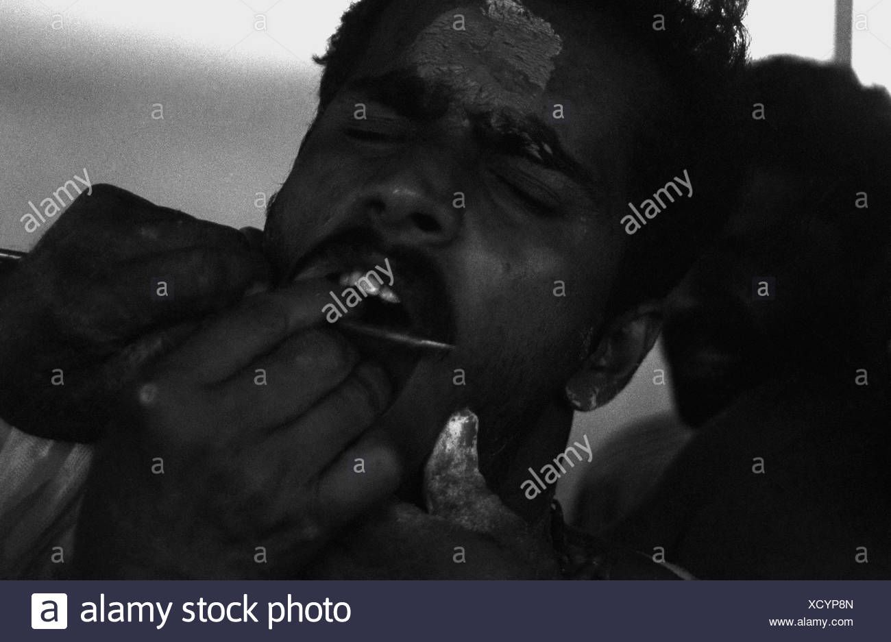 Boy experiencing pain - Stock Image