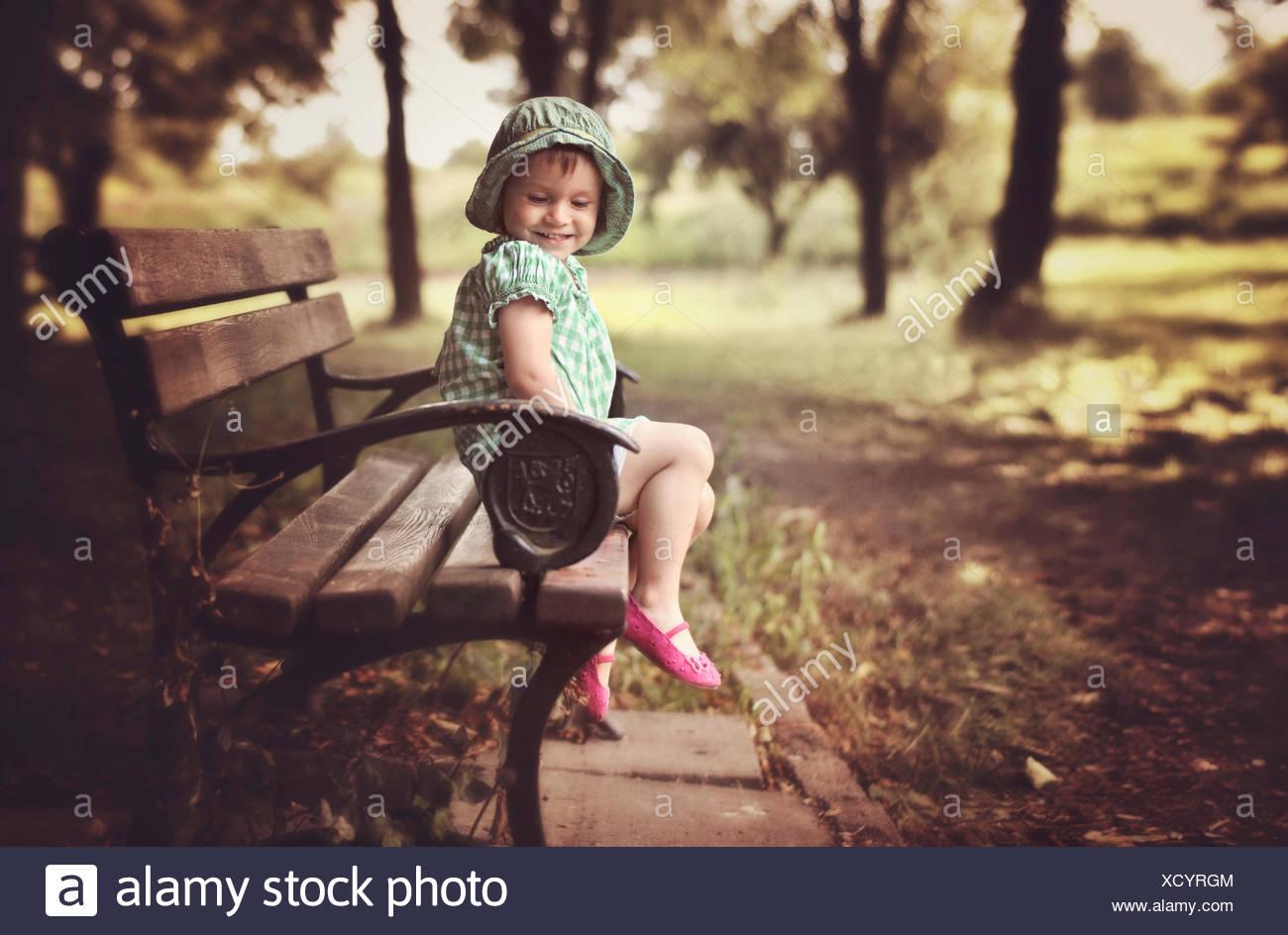 Girl on Bench - Stock Image