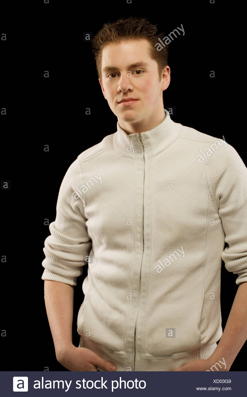 Young man wearing a zippered sweater - Stock Image