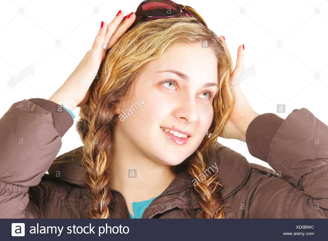 Woman with plaits looking up - Stock Image