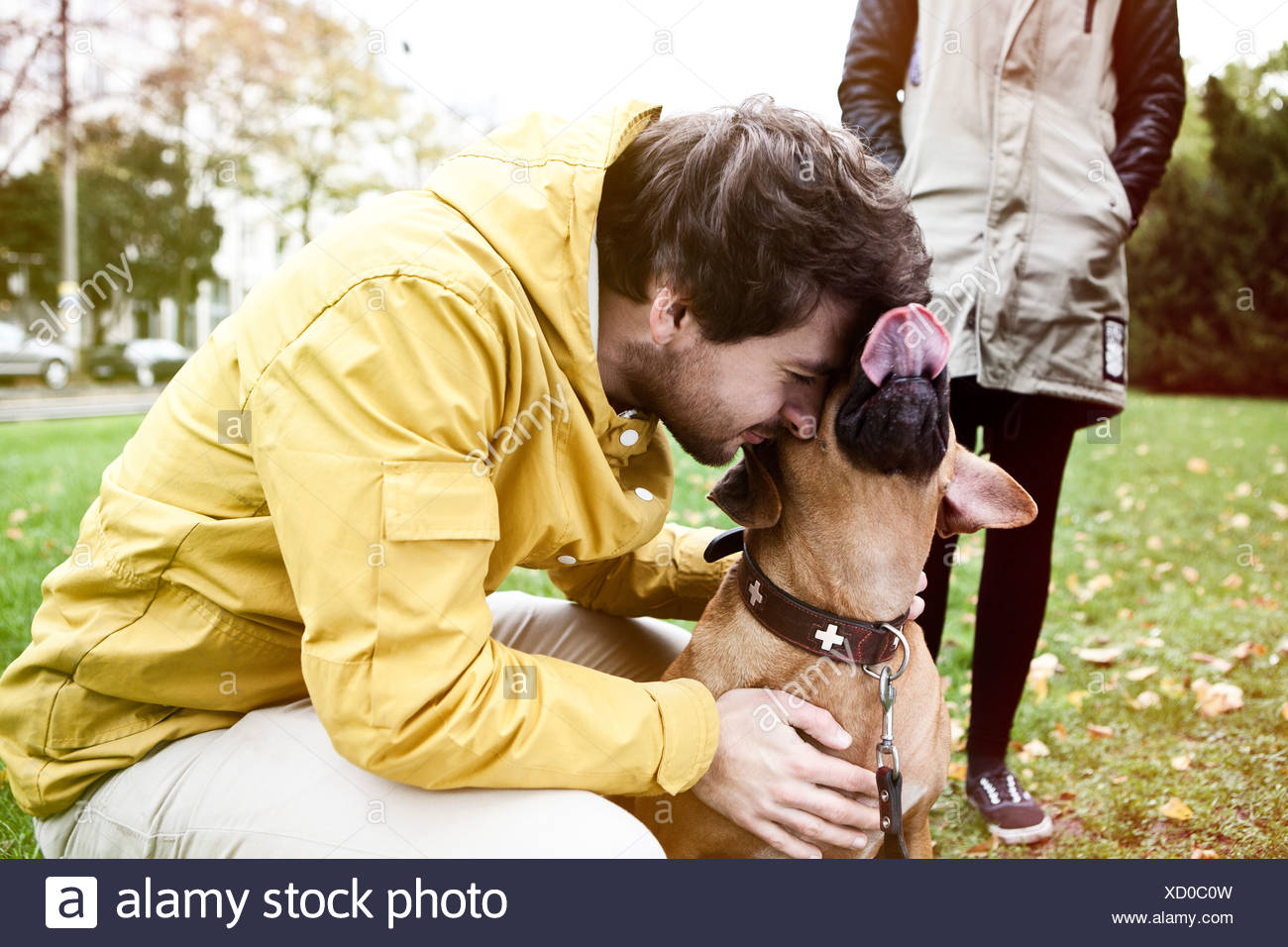 Young man and his dog - Stock Image