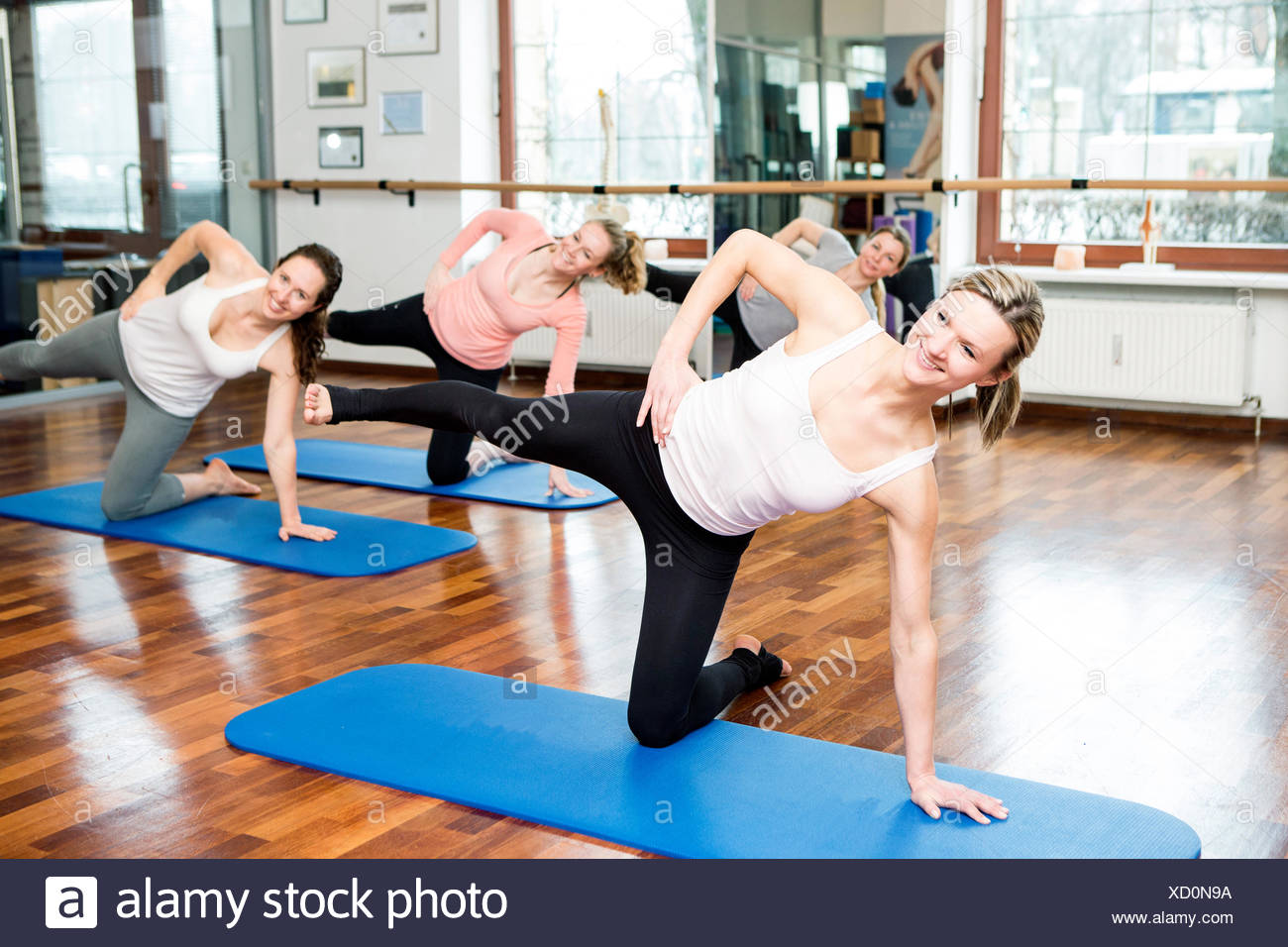Group of women doing Pilates exercises - Stock Image
