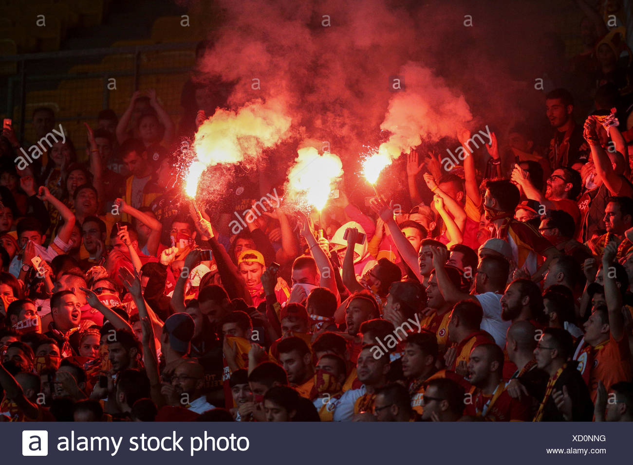 Fans of Galatasaray Istanbul cheer on their team during a friendly game against SK Rapid Vienna, Ernst-Happel-Stadium, Vienna - Stock Image