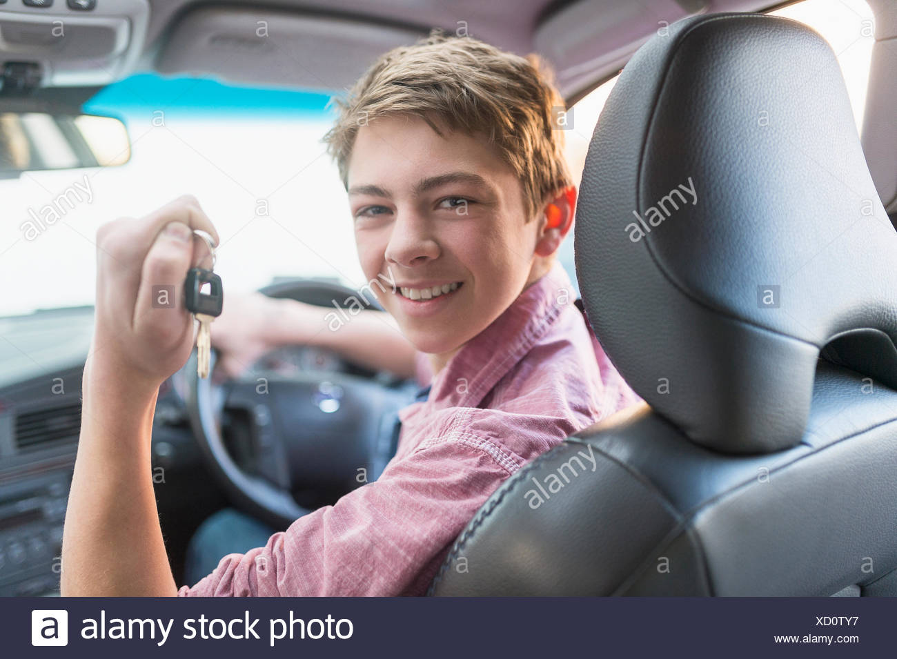 Teenage boy (16-17) driving his first car Stock Photo