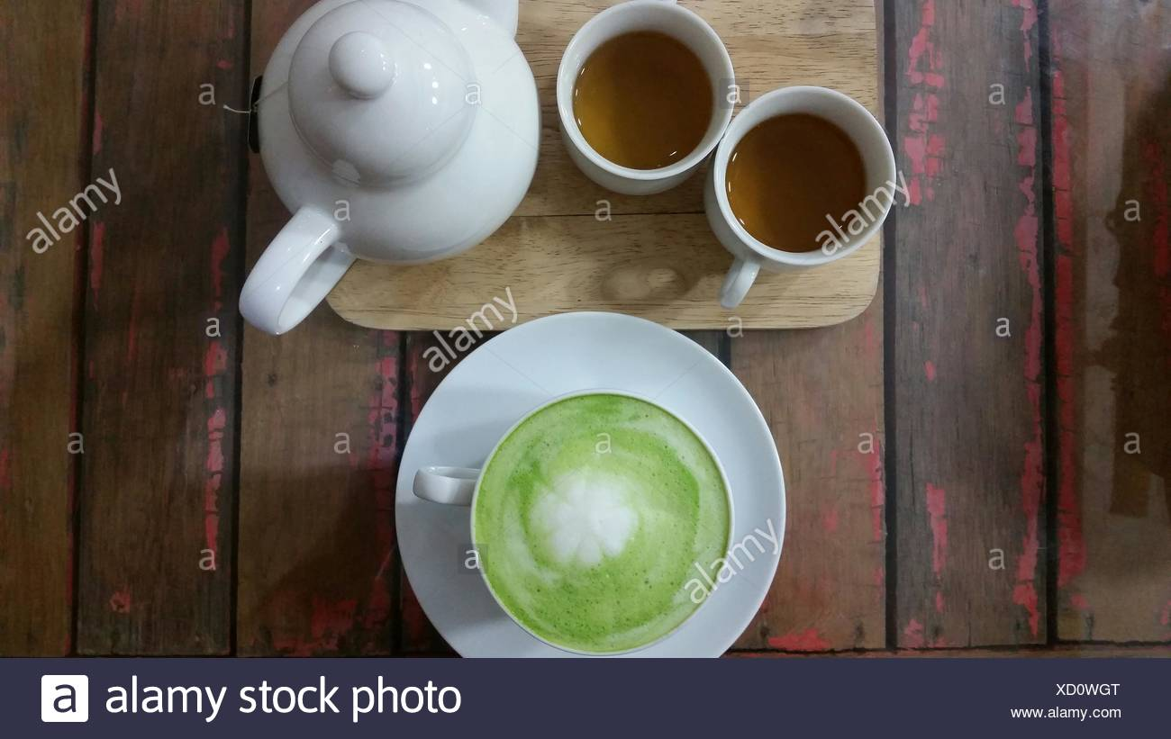 Matcha Latte And Two Cups Of Tea Stock Photo