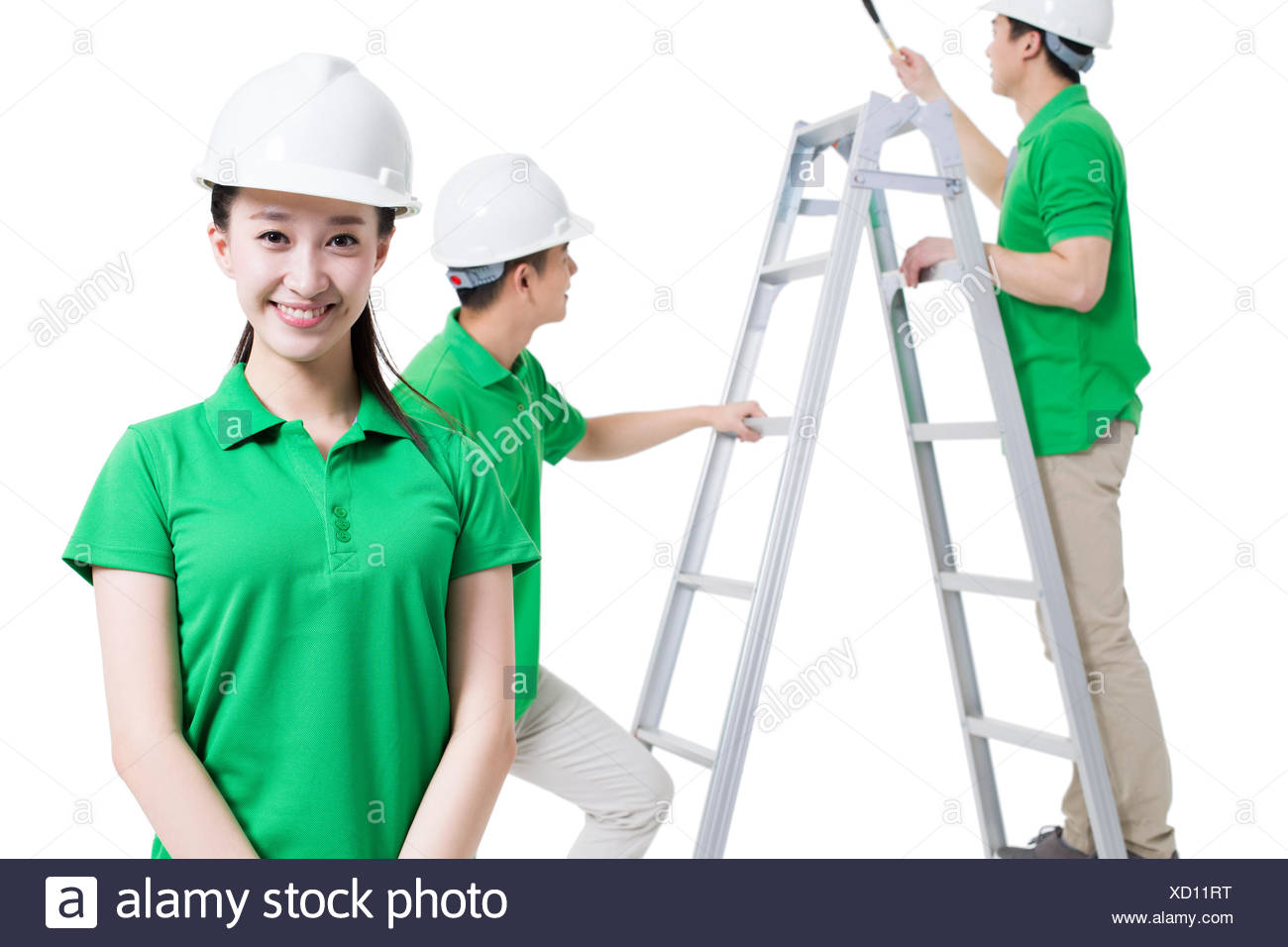 Volunteers working on construction site - Stock Image