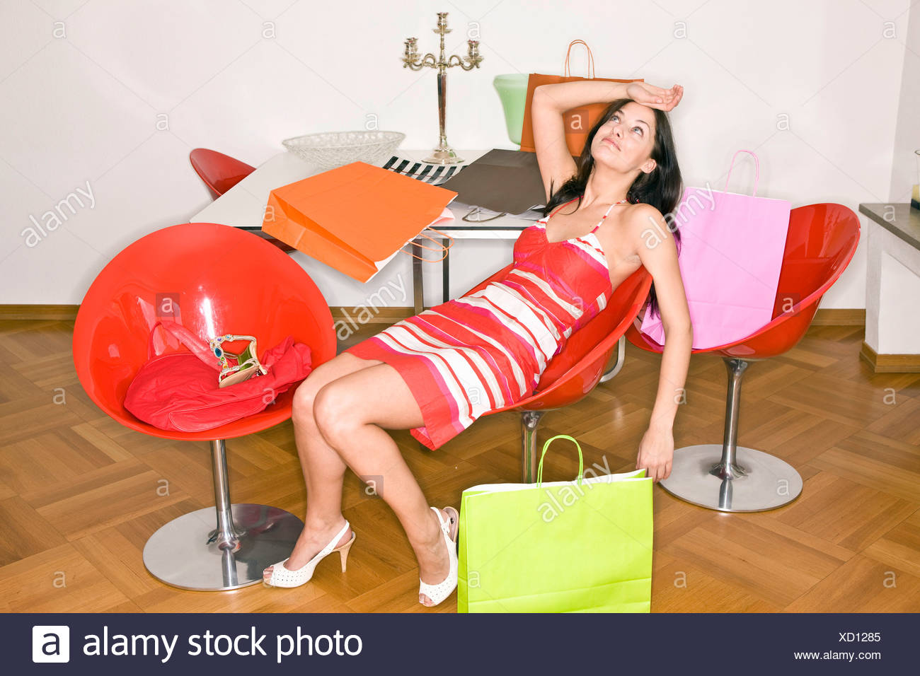 Young woman exhausted after shopping - Stock Image