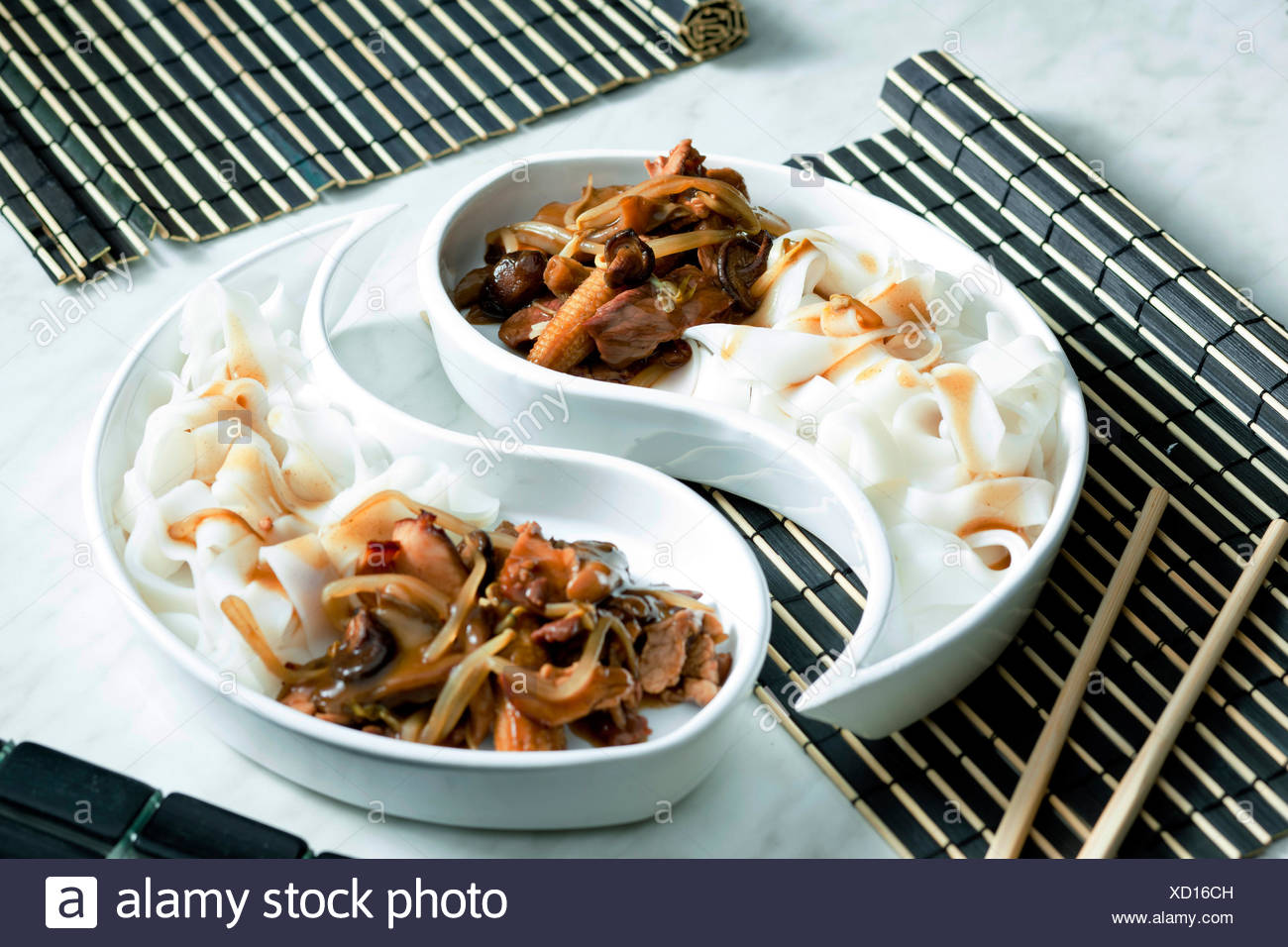poultry meat with corn and shitake mushrooms - Stock Image