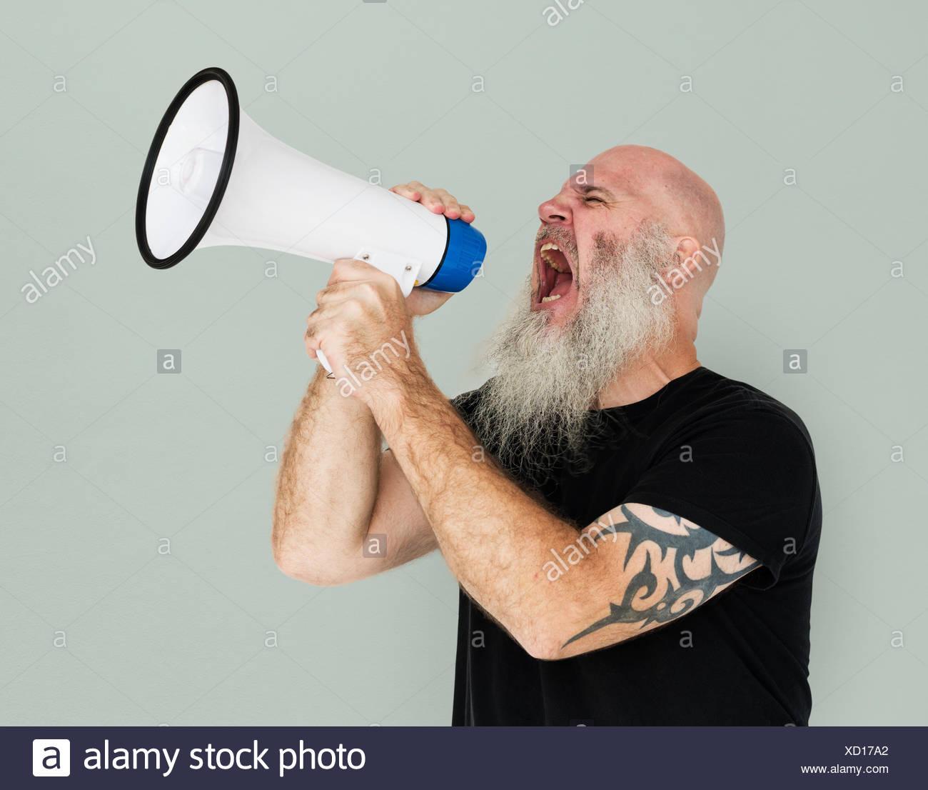 Bearded Caucasian Man Shouting Megaphone - Stock Image