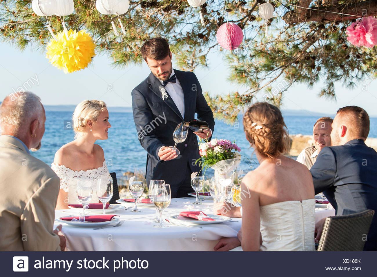 Wedding party on the beach - Stock Image
