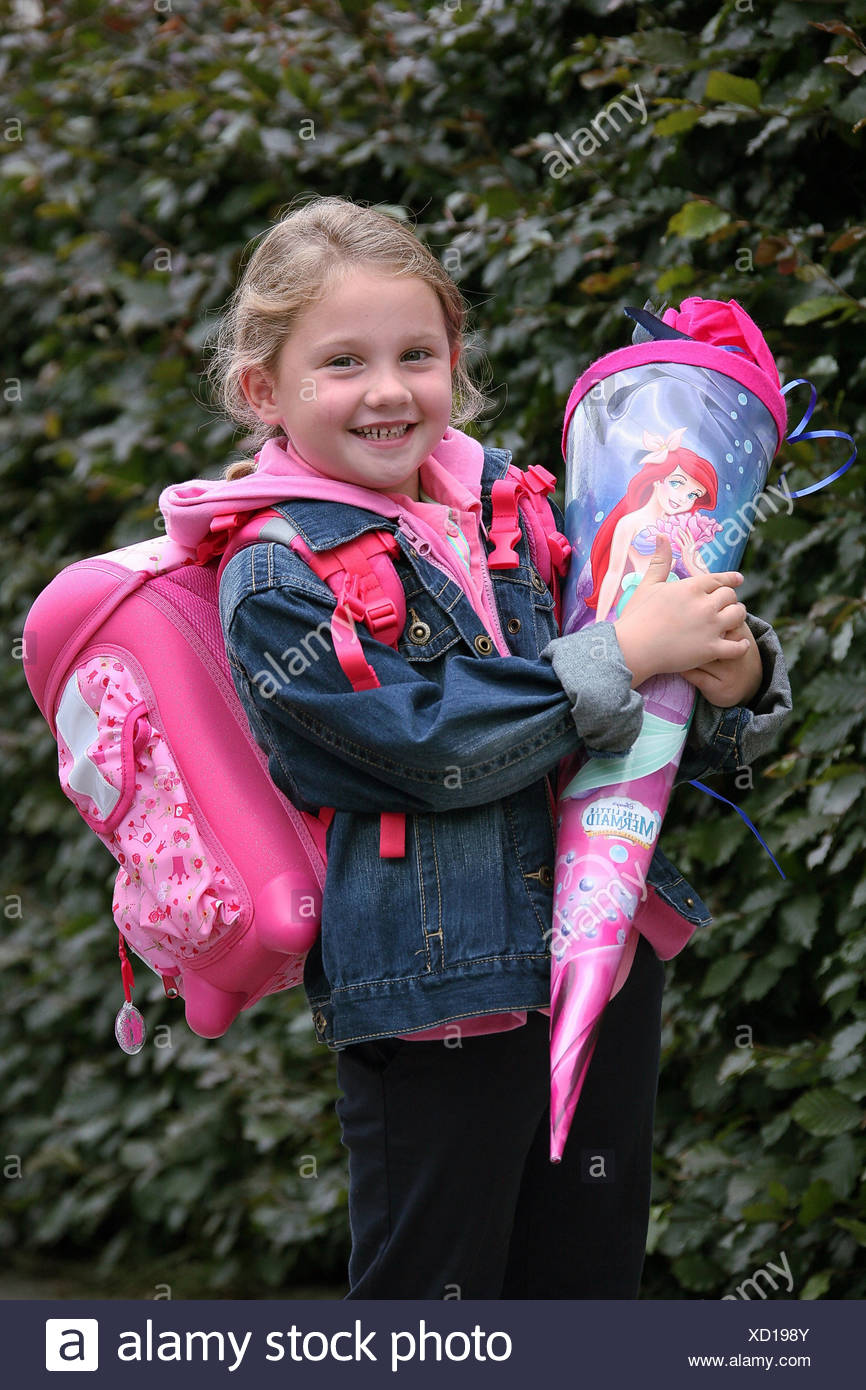 First-grader with a miscounsel satchel and a school-cornet - Stock Image
