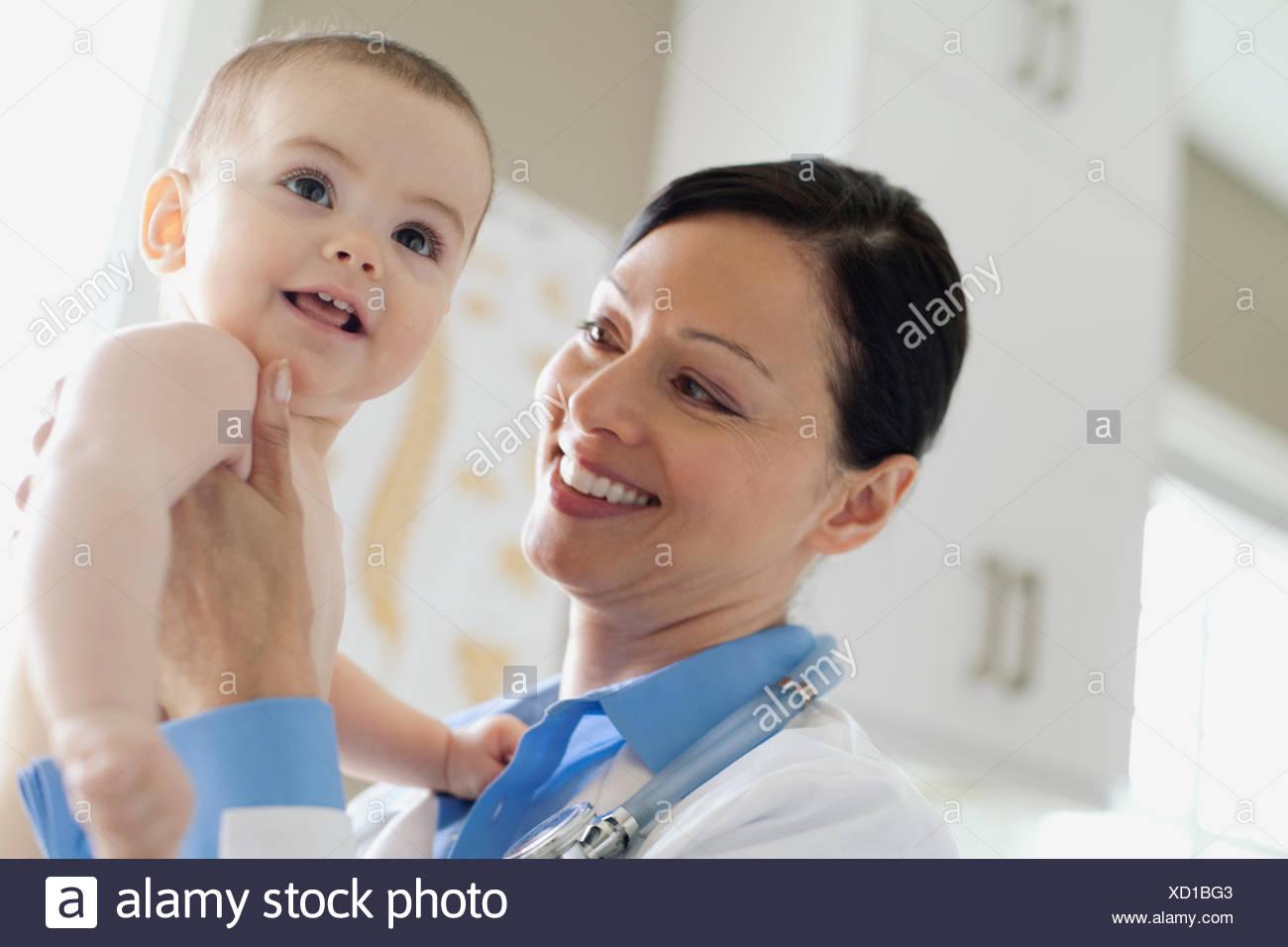 doctor examining baby - Stock Image