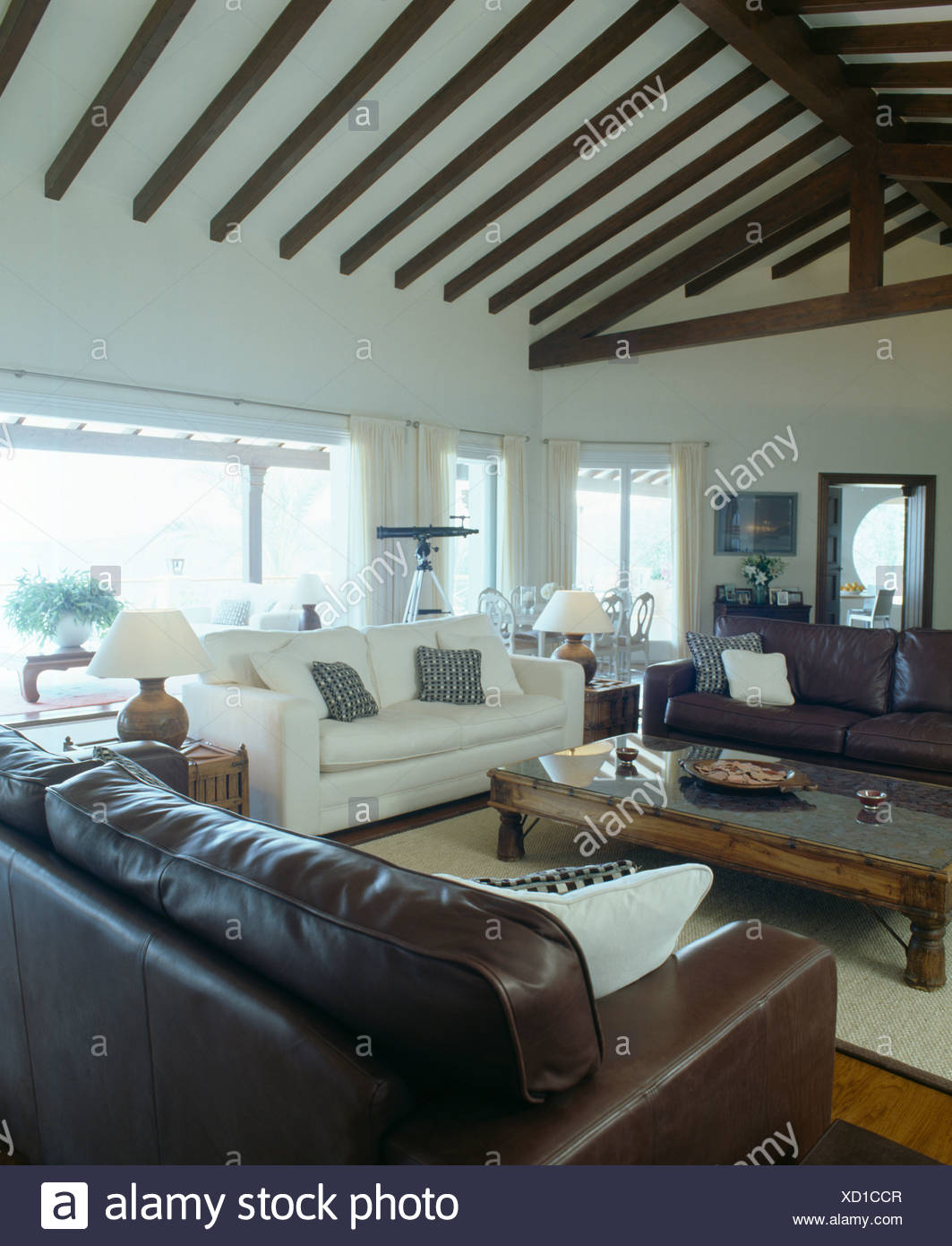 Brown Leather Sofas And White Sofa In Modern Coastal Living