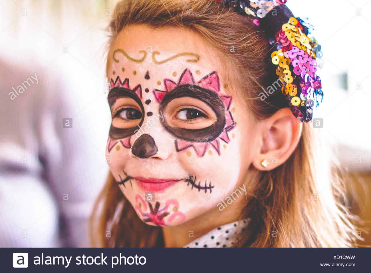 Girl (4-5) with painted face - Stock Image