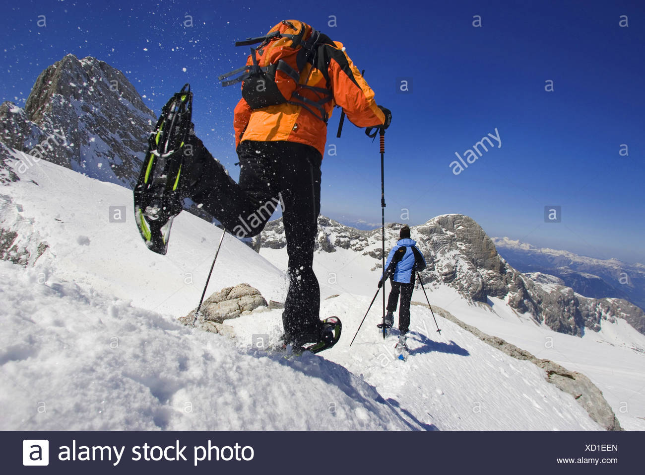 two hikers in snowshoes in a snow-covered mountain landscape, Austria - Stock Image