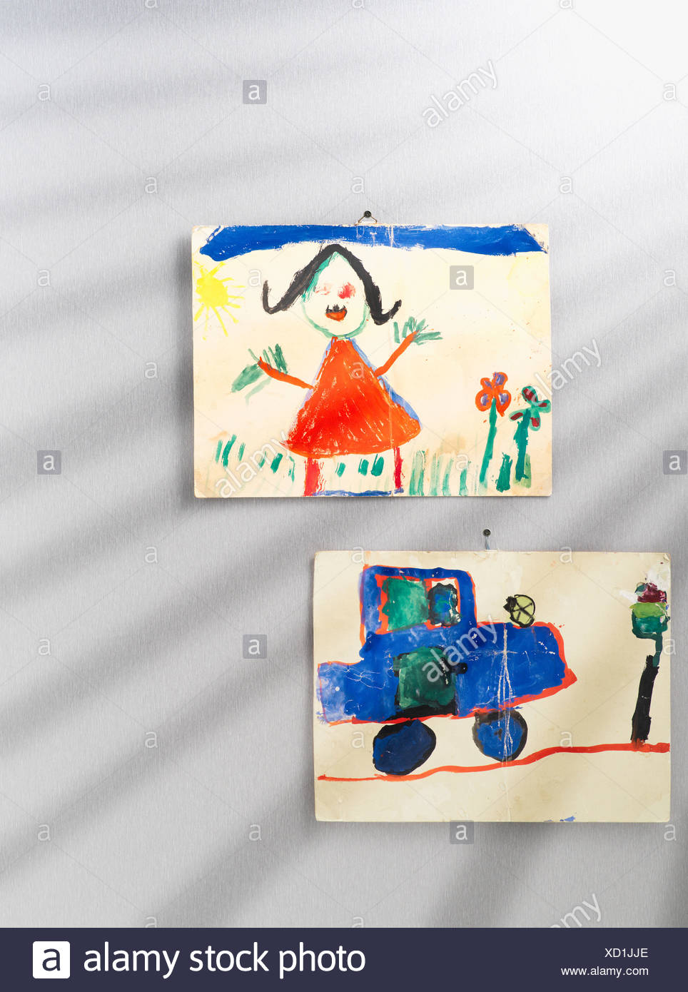 Childs pictures on a wall - Stock Image