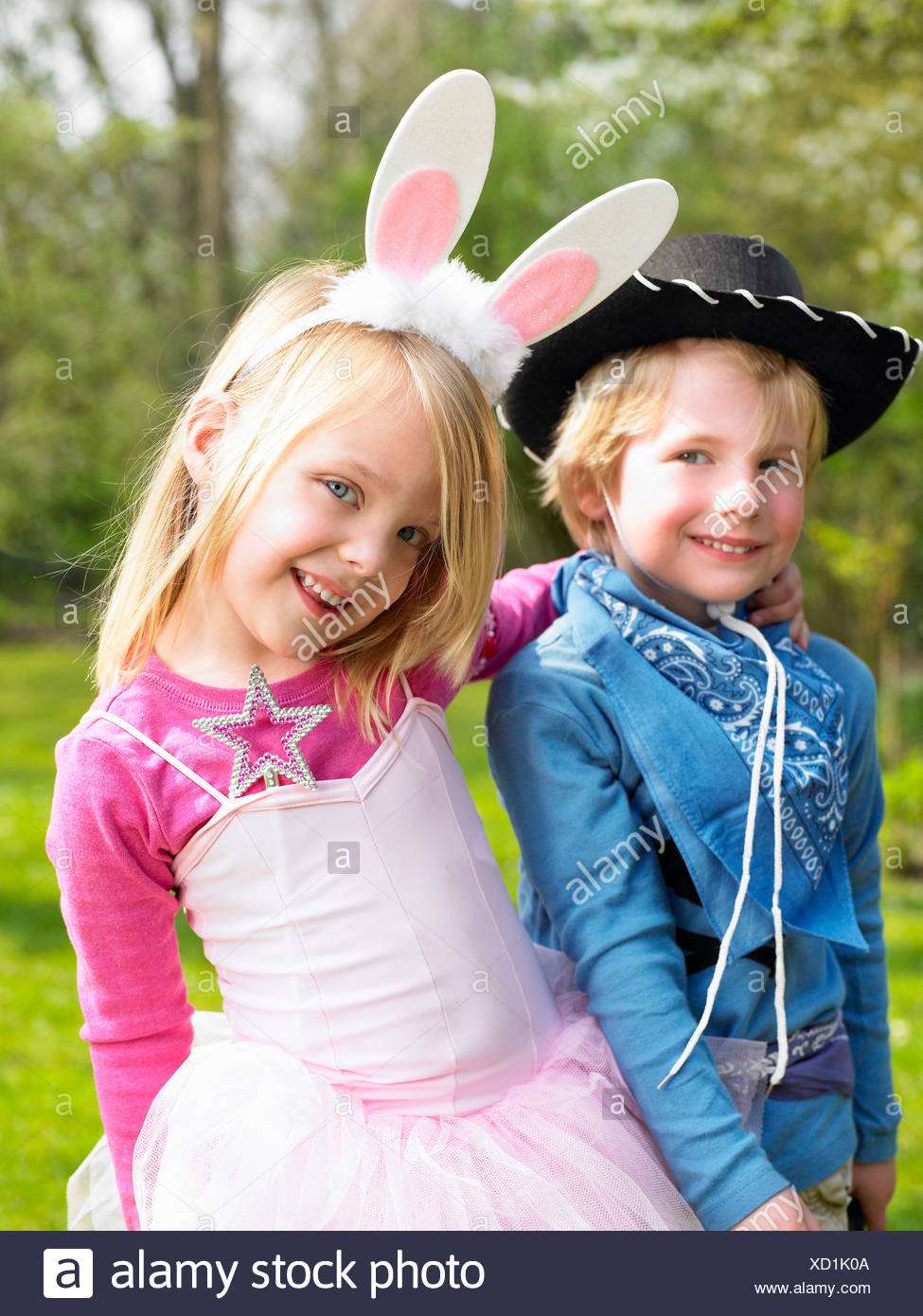 Boy and girl wearing costumes Stock Photo