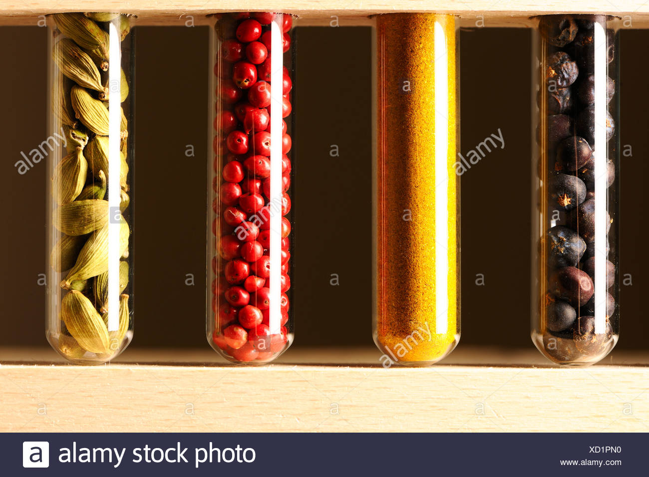 Spices in beakers - Stock Image