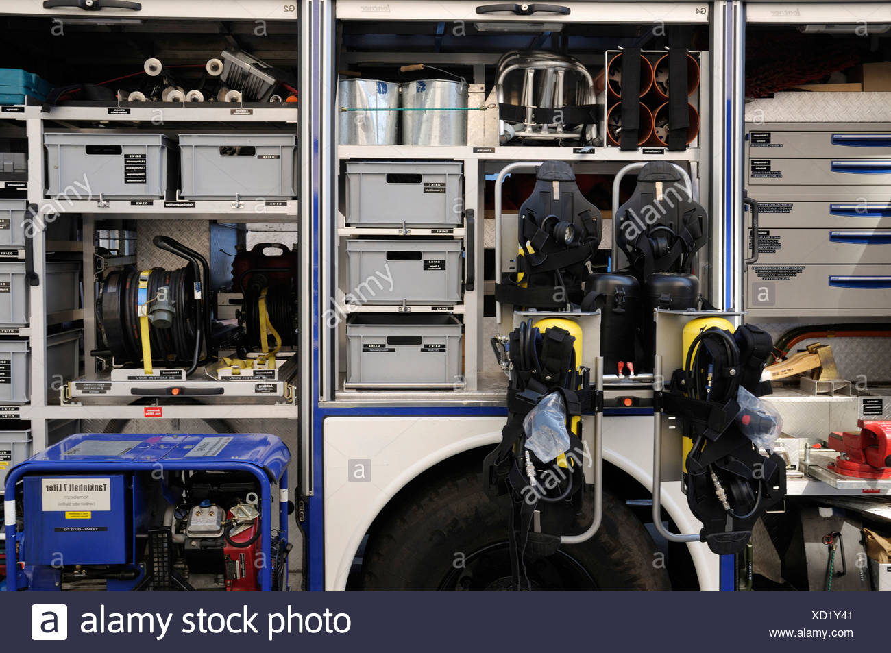 View into the compartments with safety clothes and tools of a Technisches Hilfswerk truck, THW, Federal Agency for Technical Re - Stock Image
