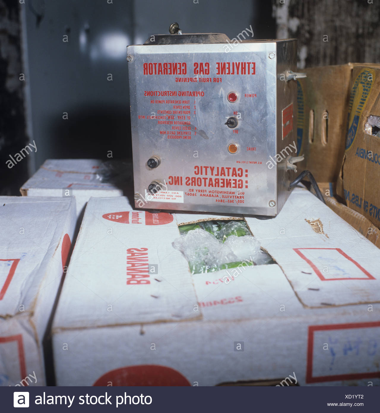 Ethylene gas generator in banana store for ripening and storage of imported fruit - Stock Image