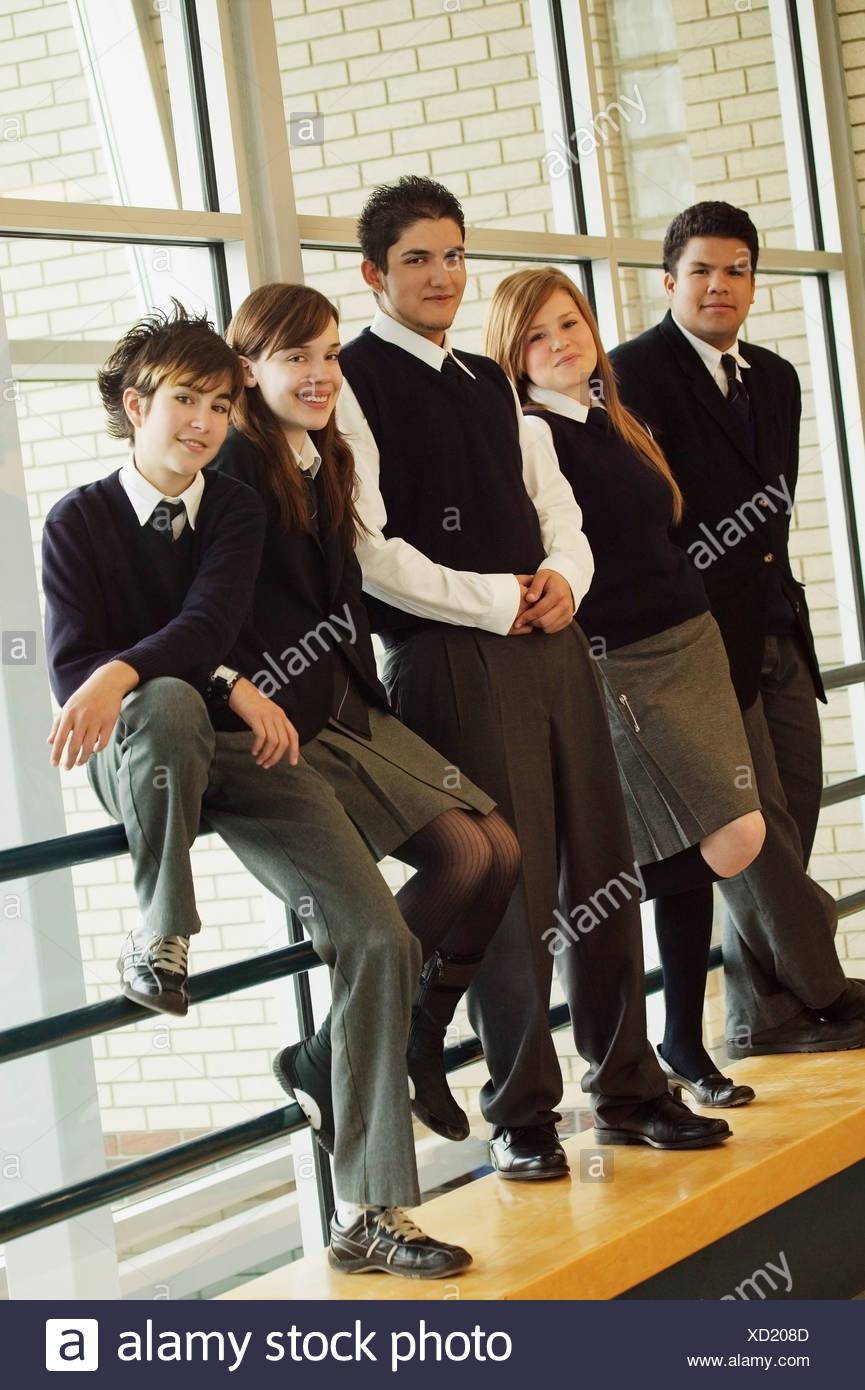 Teens in school uniforms - Stock Image