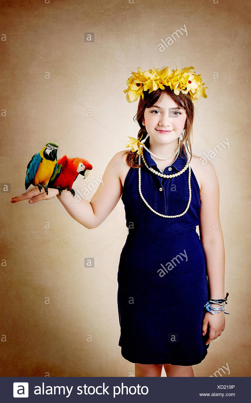 Girl holding two parrots - Stock Image