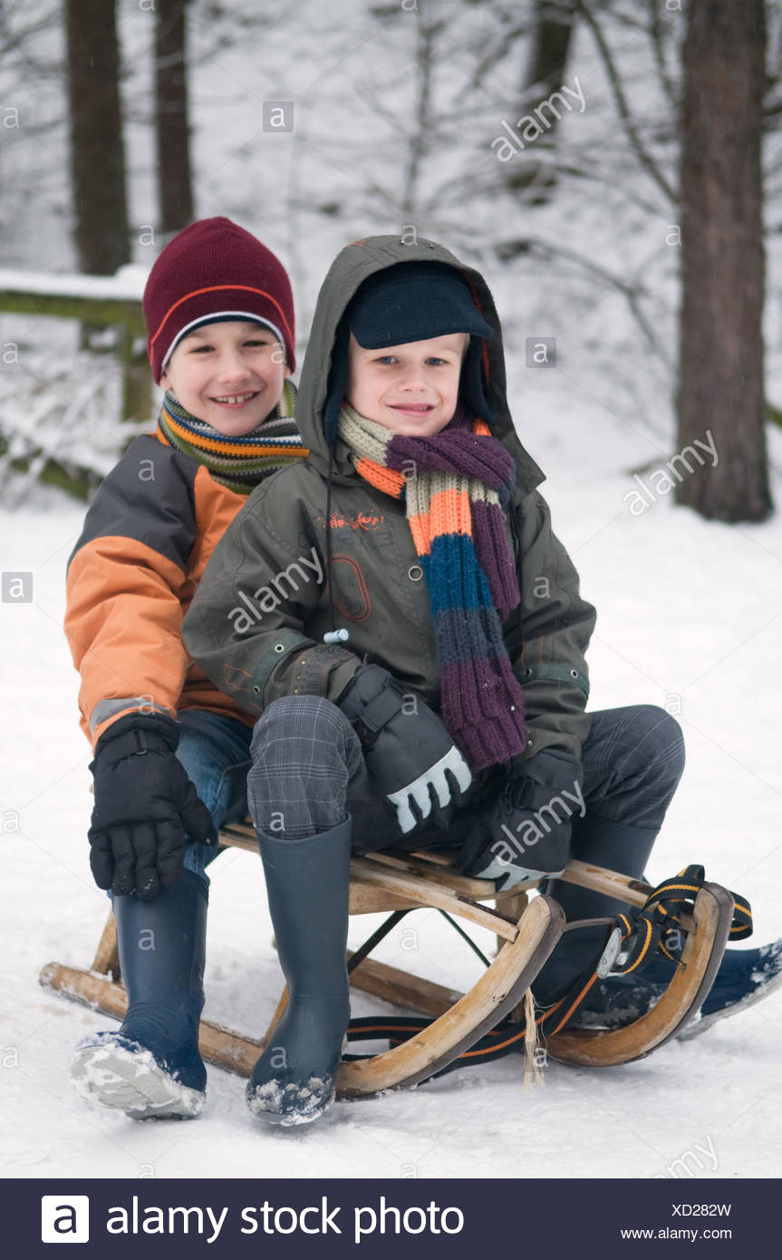 Boys On A Sled - Stock Image