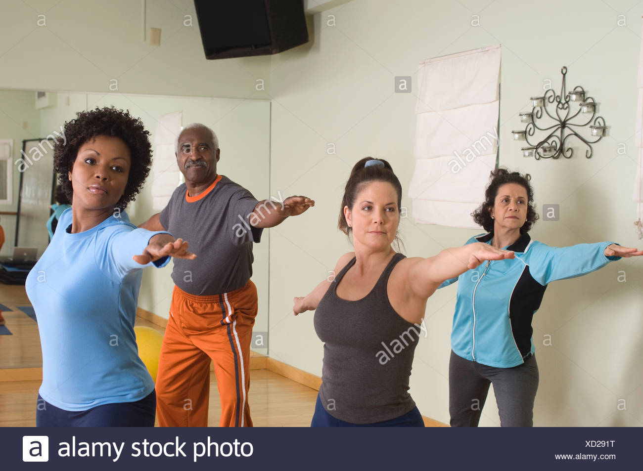 Stretching in Yoga Class - Stock Image