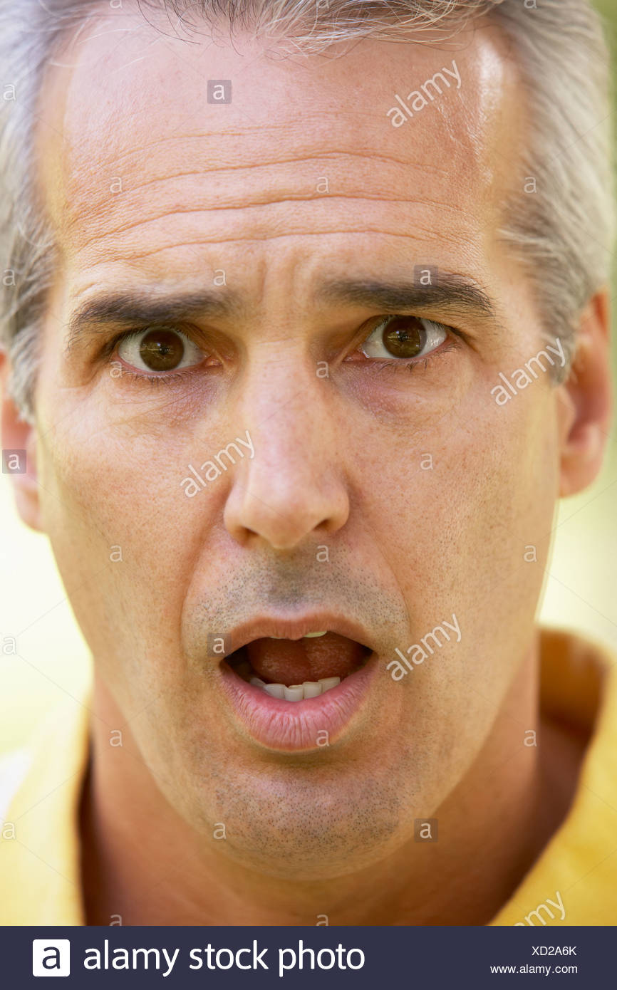 Portrait Of Surprised Middle Aged Man - Stock Image