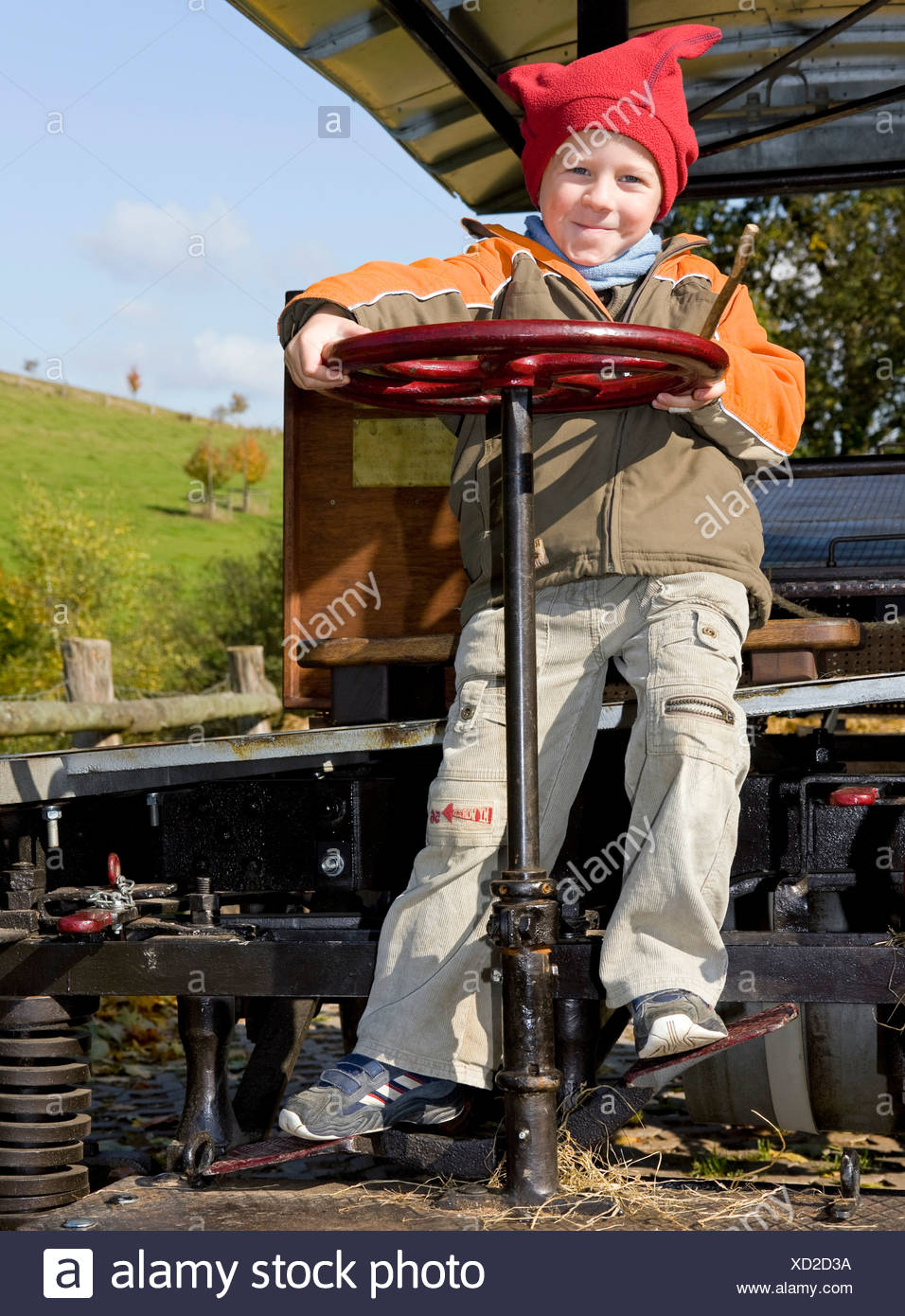 Boy, 5 years old, playing on a historic vehicle Stock Photo
