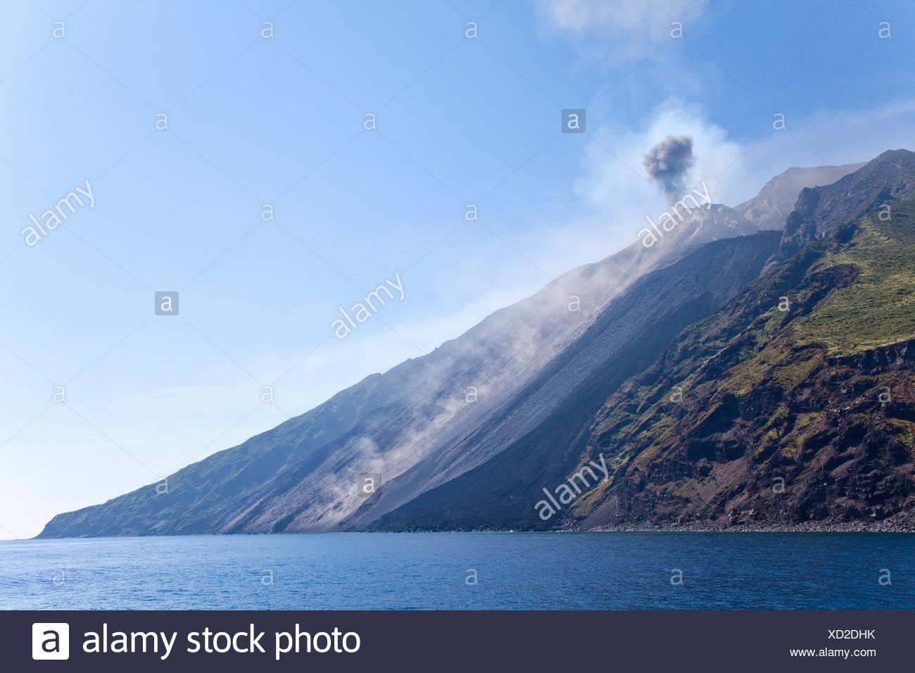 Volcano Stromboli erupting a cloud of smoke, Italy - Stock Image